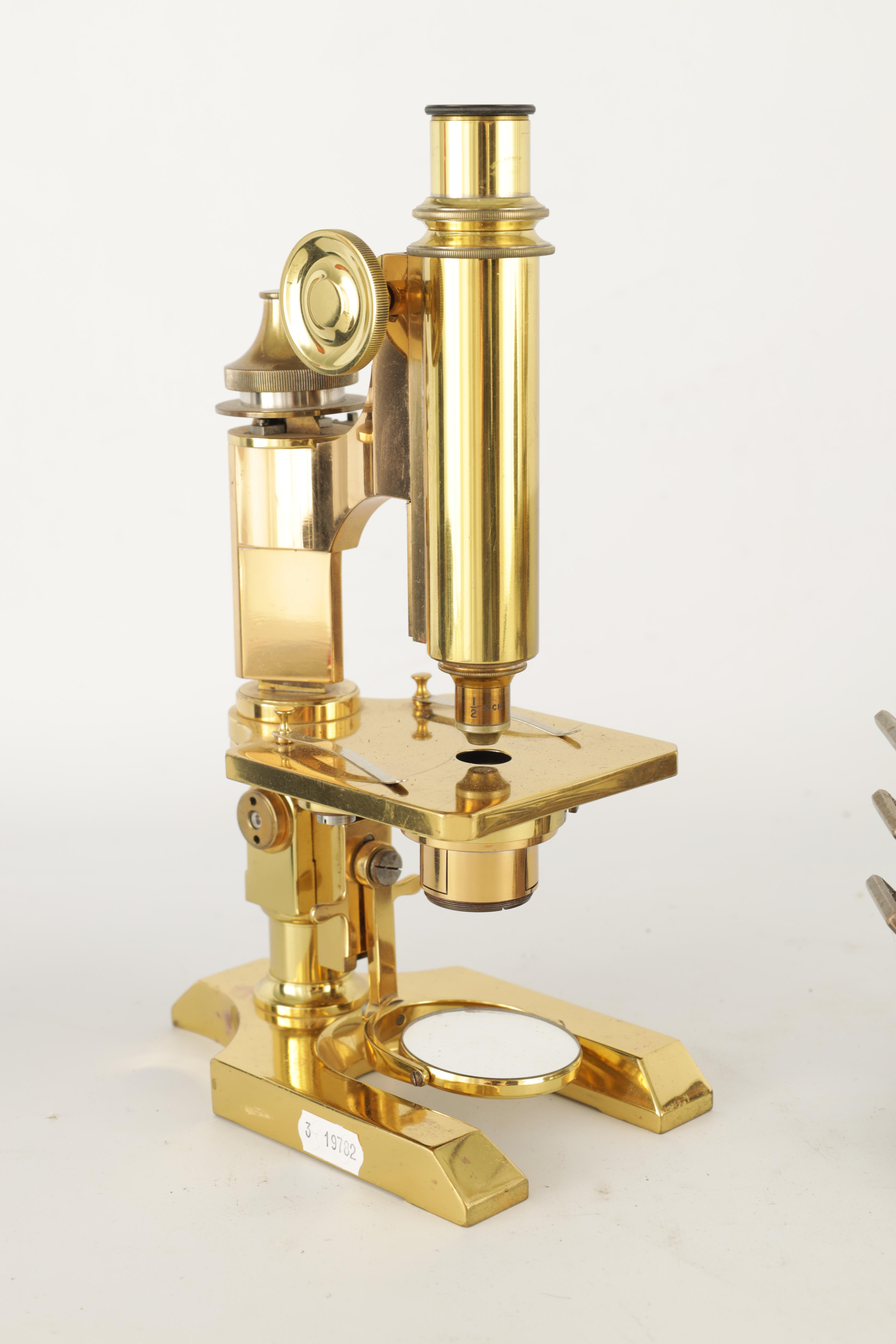 A 19TH CENTURY LACQUERED BRASS MONOCULAR MICROSCOPE with shaped base and rack and pinion focusing - Image 2 of 4