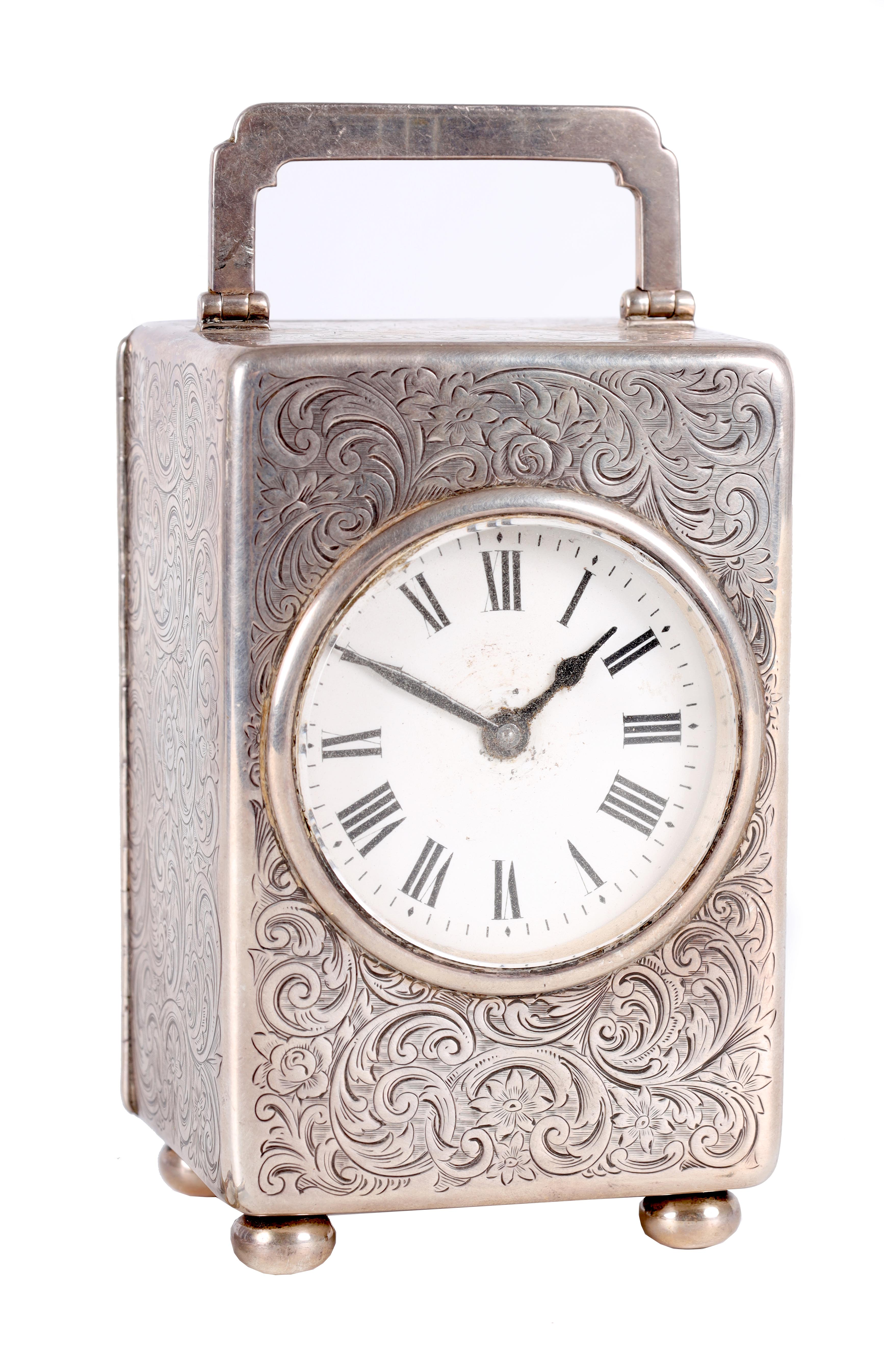 A LARGE EARLY 20TH CENTURY SILVER CASED CARRIAGE CLOCK the case covered with scrolling foliated