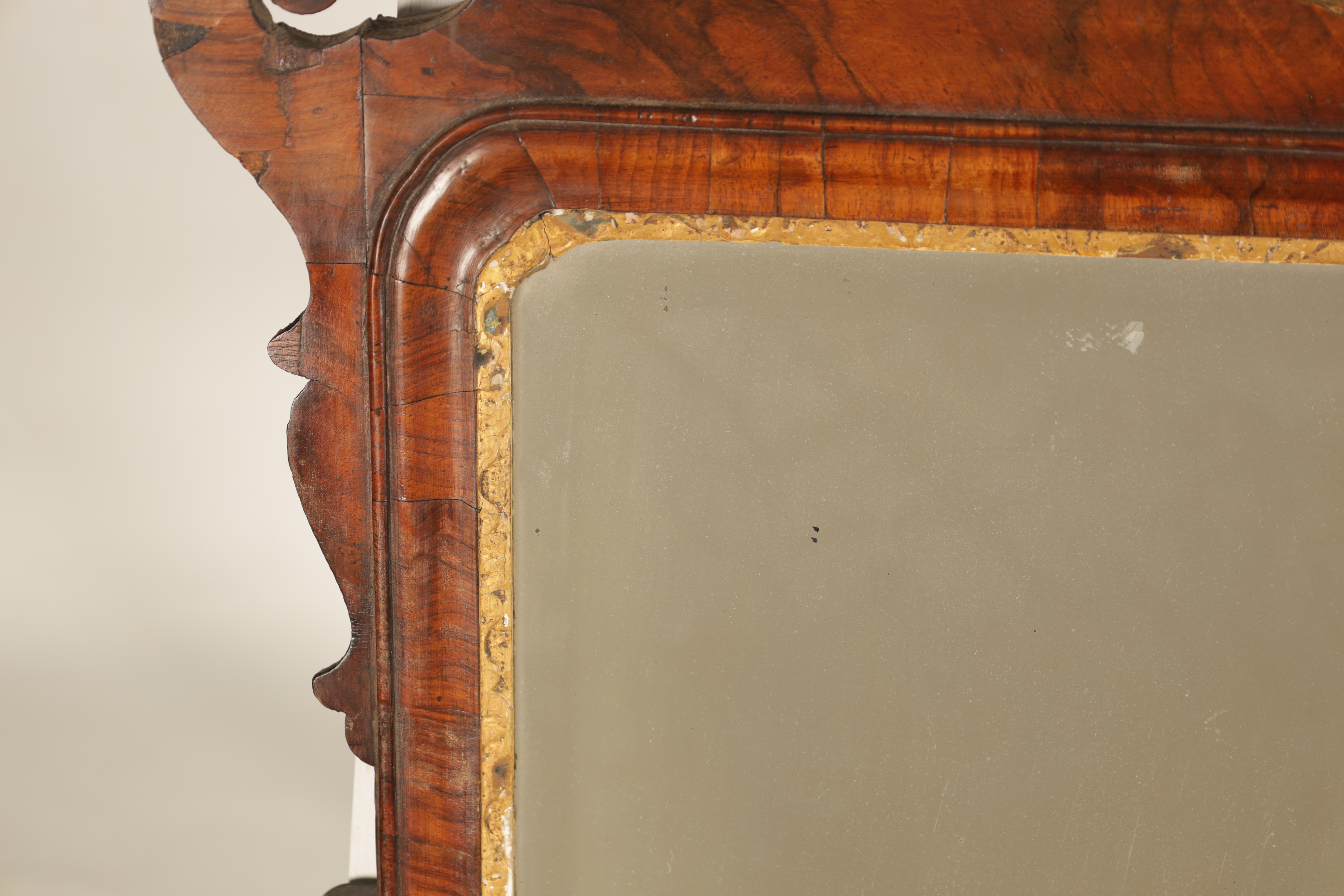 AN 18TH CENTURY WALNUT PIER MIRROR with shaped scrolled frame and gilt carved rococo pediment, the - Image 4 of 5