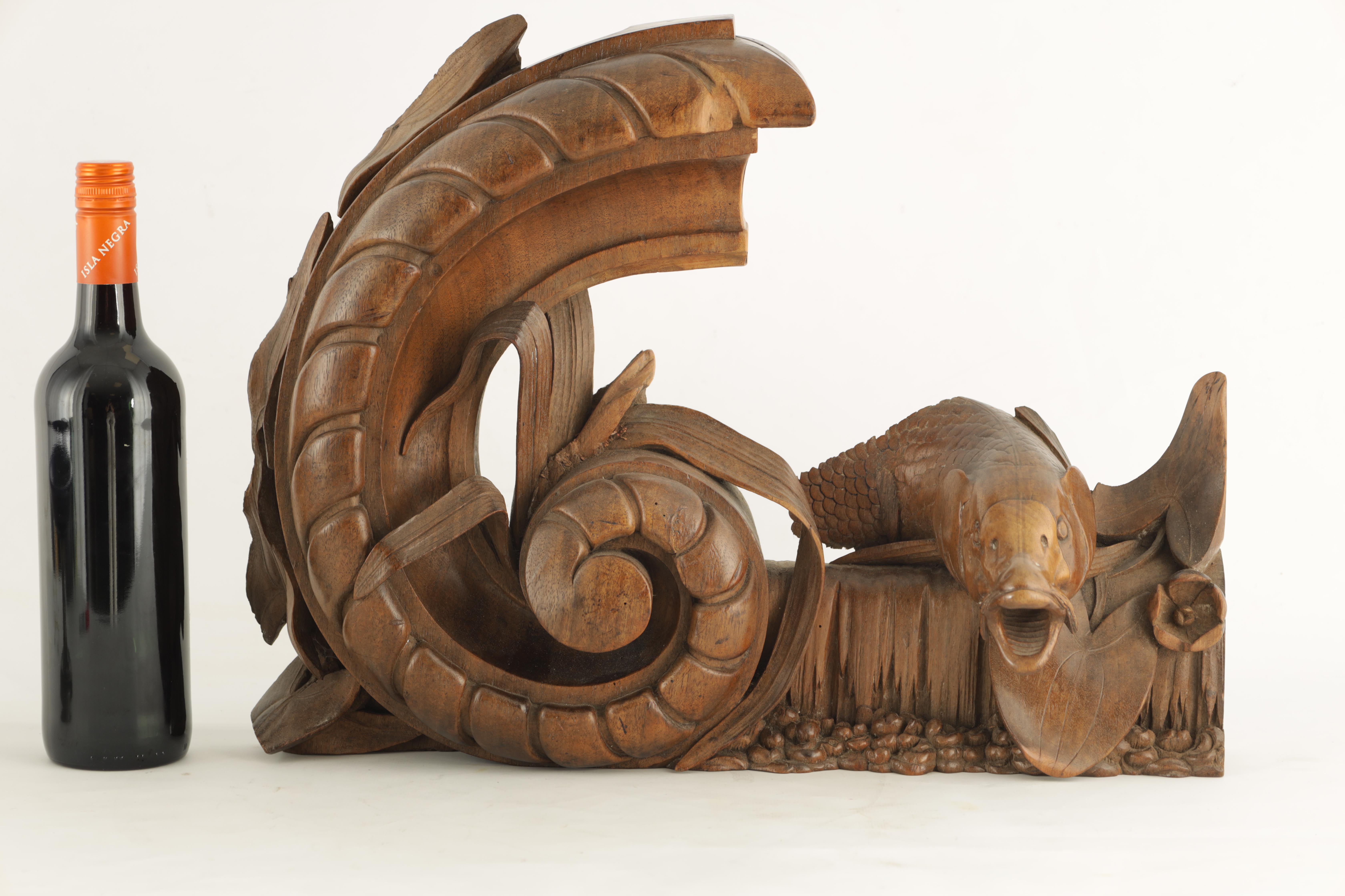 A 19TH CENTURY WALNUT CARVING OF A CARP next to a gadrooned scroll with reeds 49cm wide 38cm high - Image 5 of 6