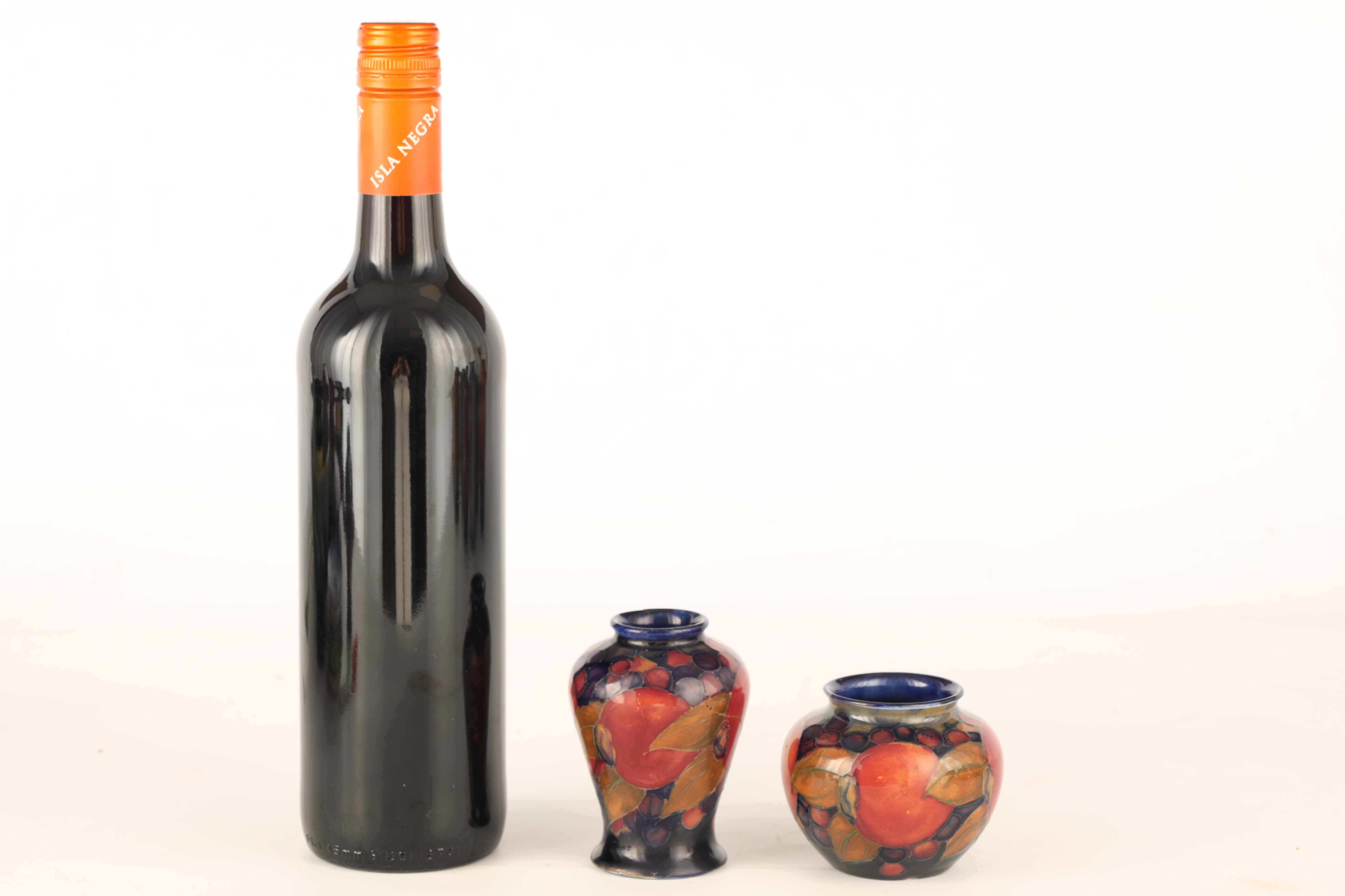 A 1920S MOORCROFT MINIATURE SQUAT BULBOUS VASE tube lined and decorated in the Pomegranate pattern - Image 2 of 5