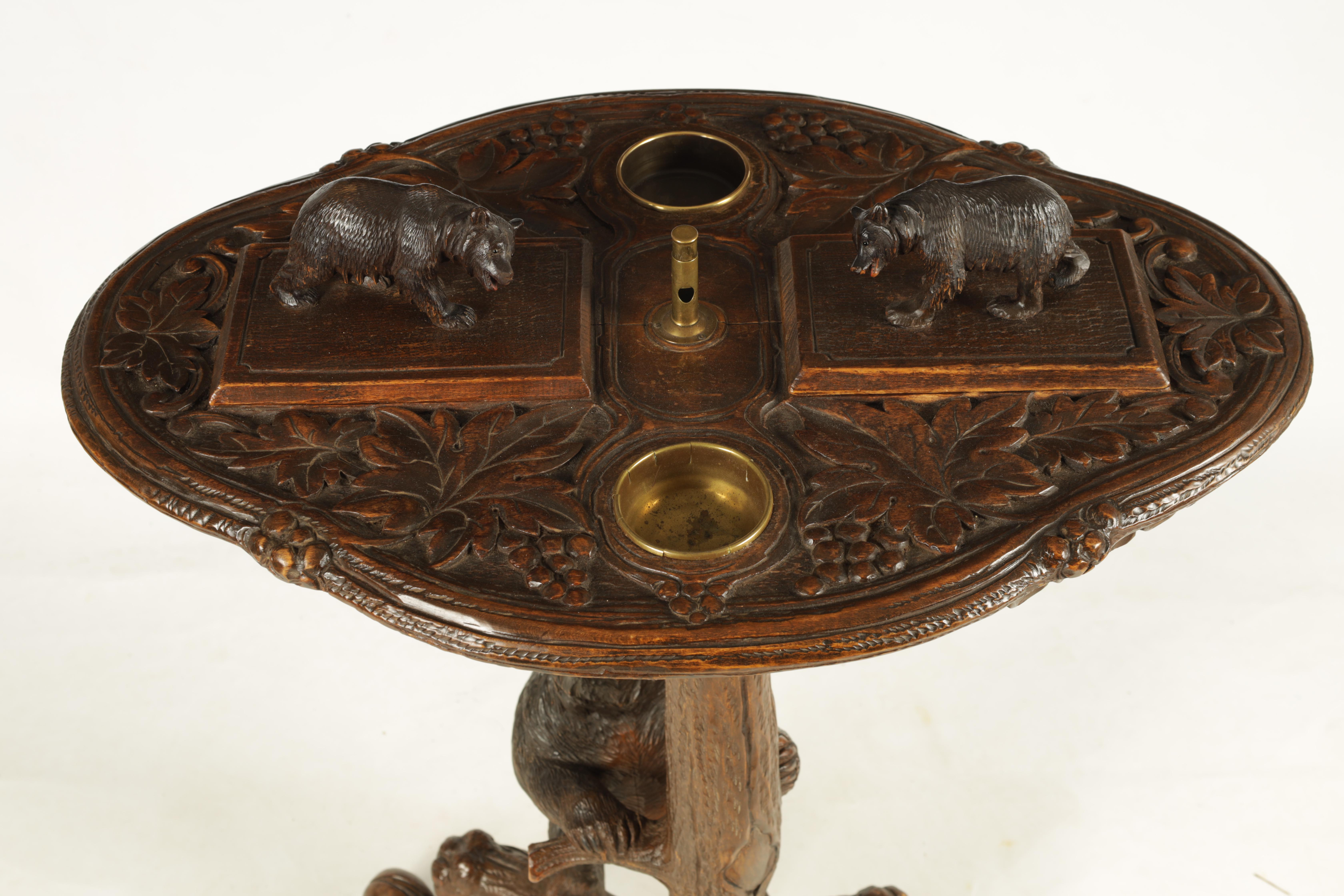 A LATE 19TH CENTURY SWISS CARVED BLACK FOREST SMOKERS TABLE with leaf carved top having two bear - Image 2 of 9