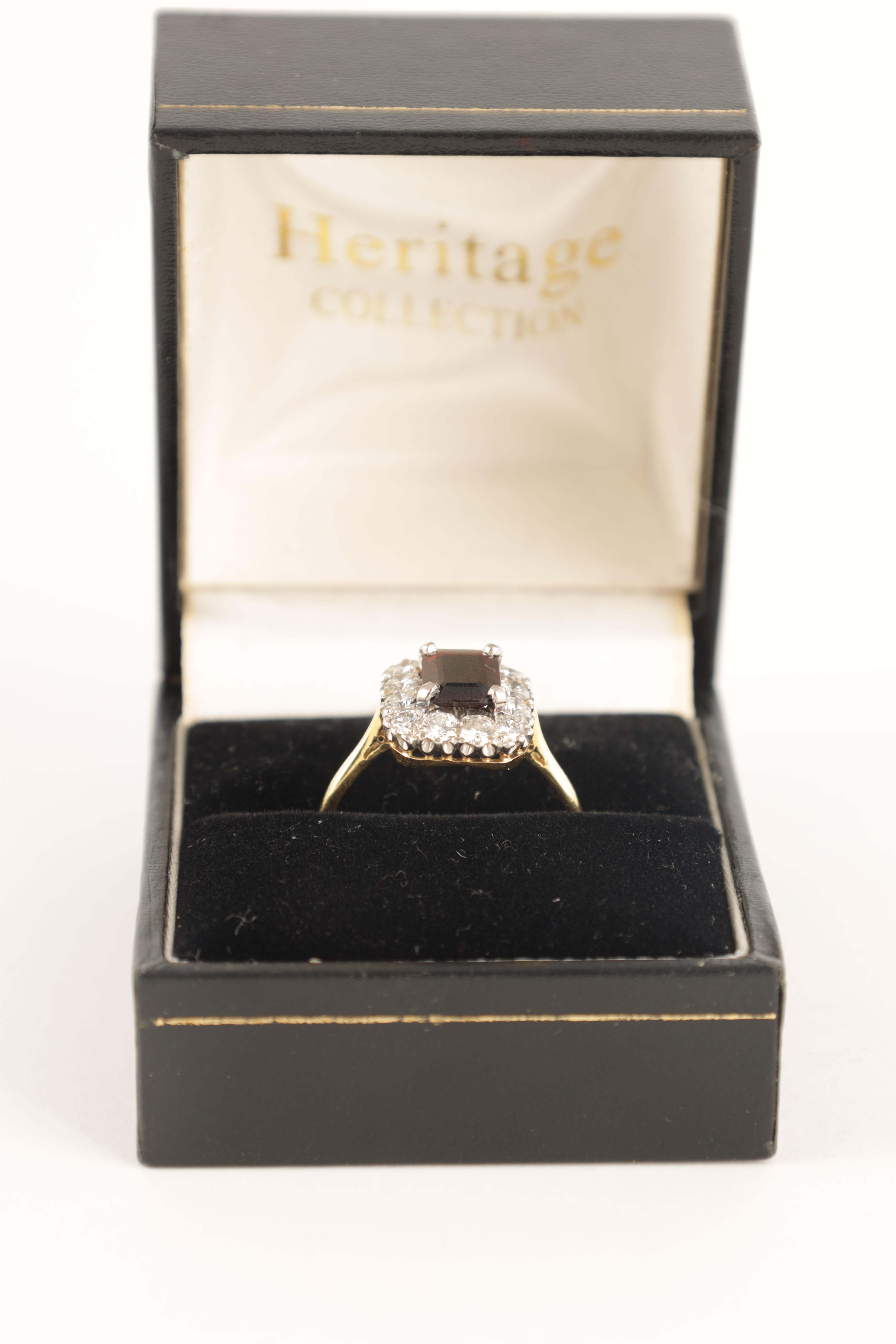 A LADIES 18CT GOLD AND PLATINUM RUBY AND DIAMOND RING with emerald cut ruby surrounded by 12 - Image 2 of 4