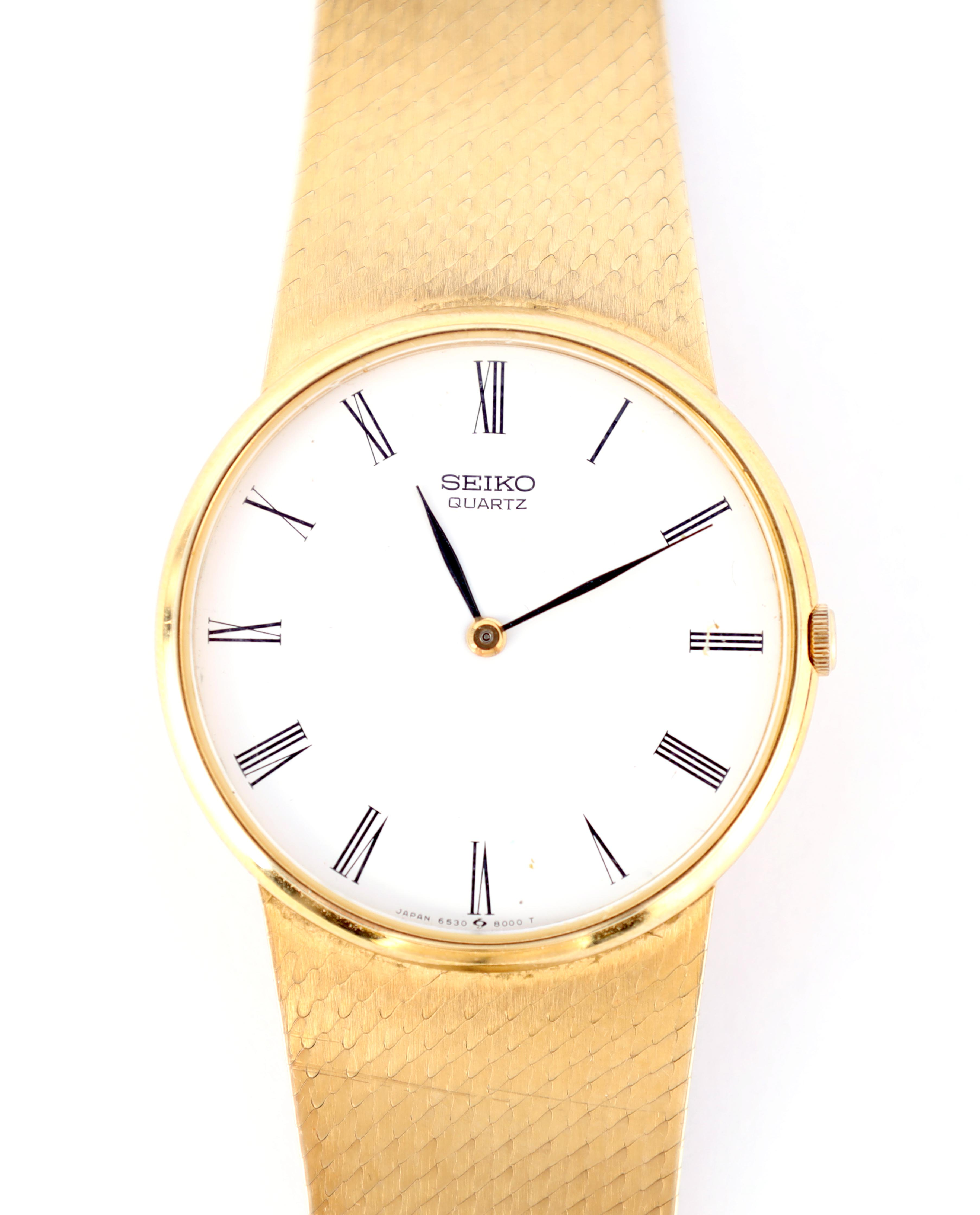 A GENTLEMAN'S 9CT GOLD SEIKO WRISTWATCH on original 9ct gold bracelet The white enamel dial with - Image 6 of 8