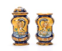 A PAIR OF CASTEL DURANTE MAIOLICA ALBARELLI DATED 1580 each painted with Venus riding a dolphin