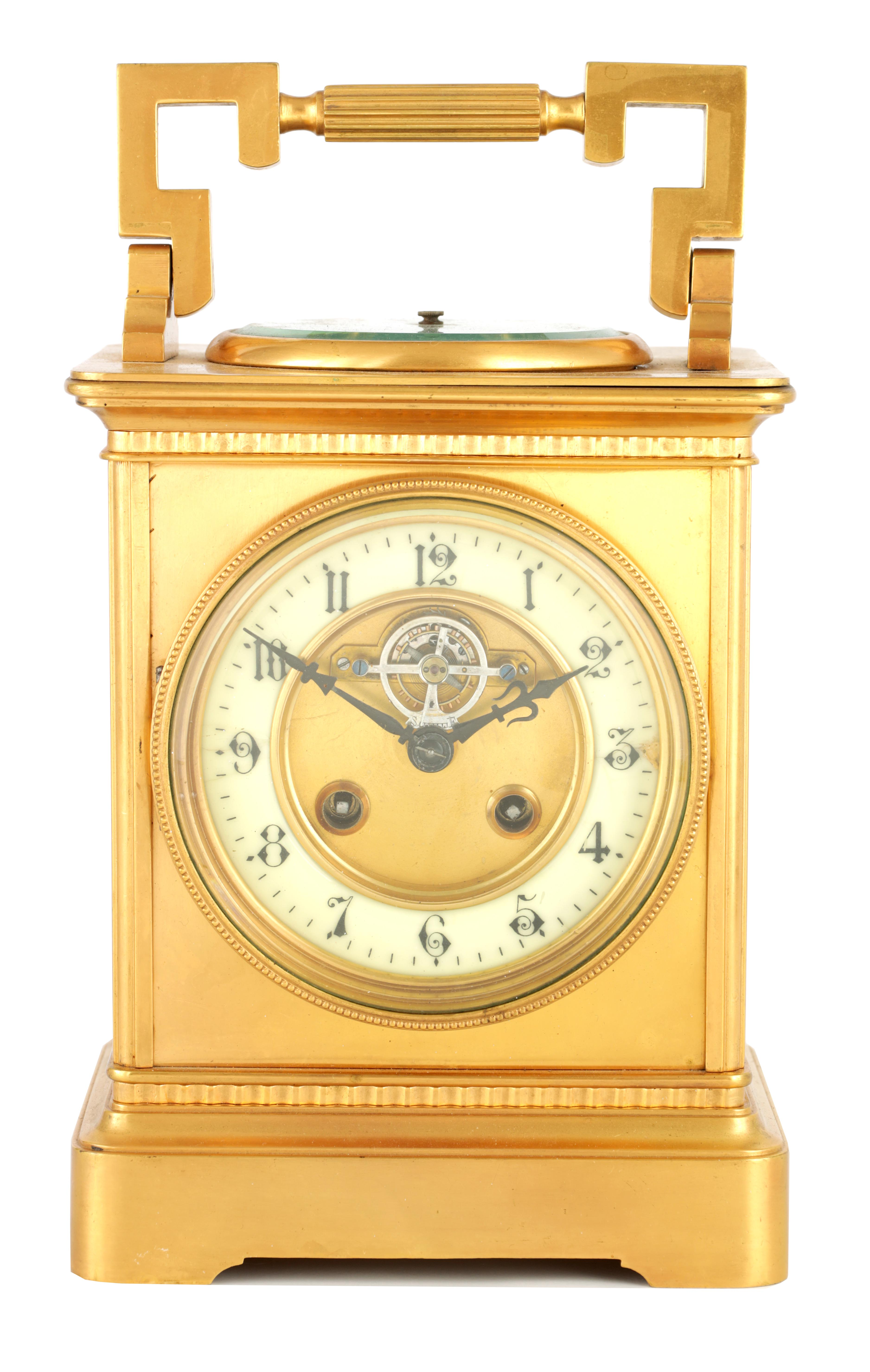 A LARGE FRENCH GILT BRASS CARRIAGE CLOCK WITH BAROMETER the moulded case with hinged handle, the top