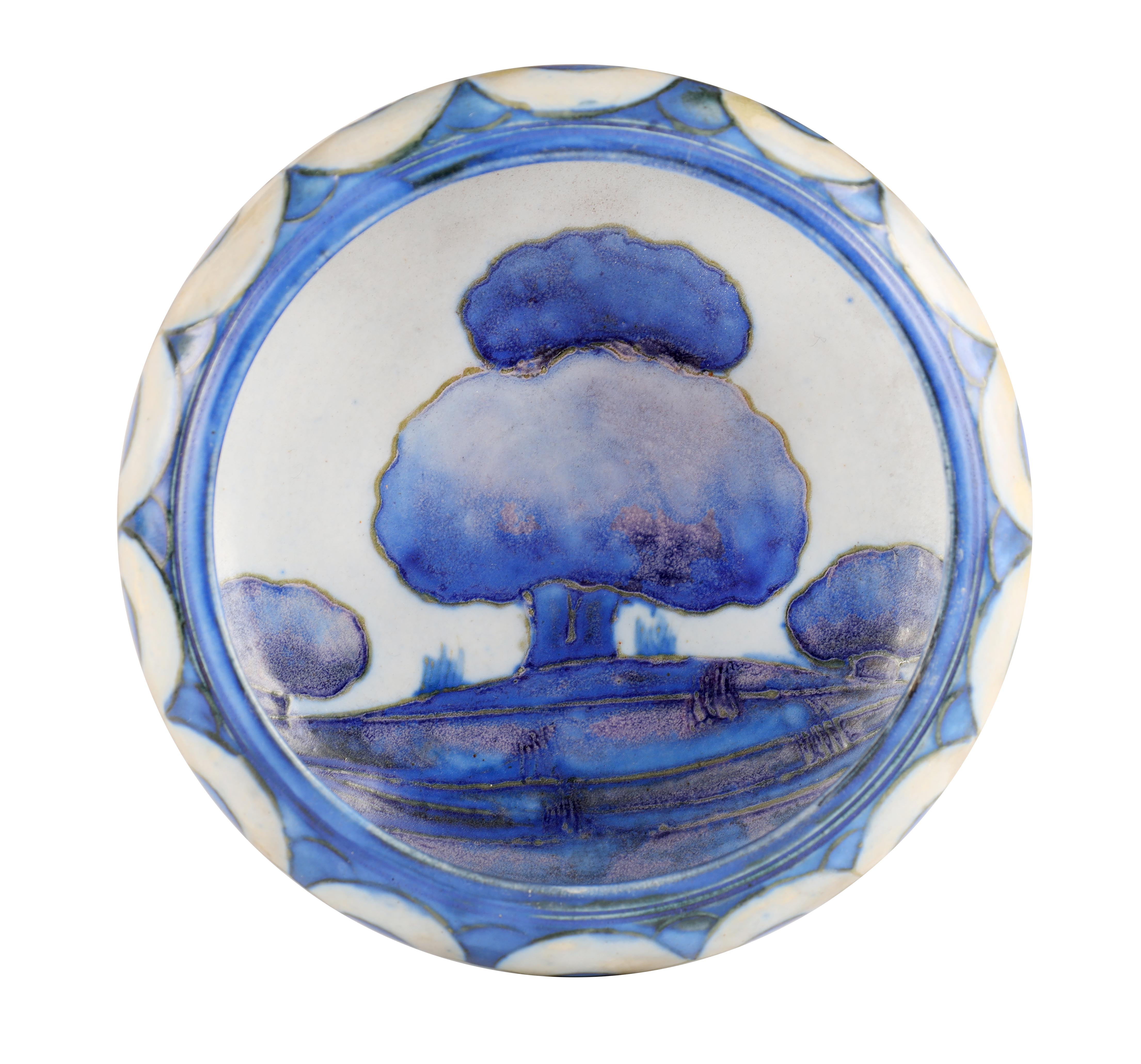 A MOORCROFT SMALL SHALLOW DISH WITH CURVED RIM decorated in the blue ground Dawn Landscape pattern