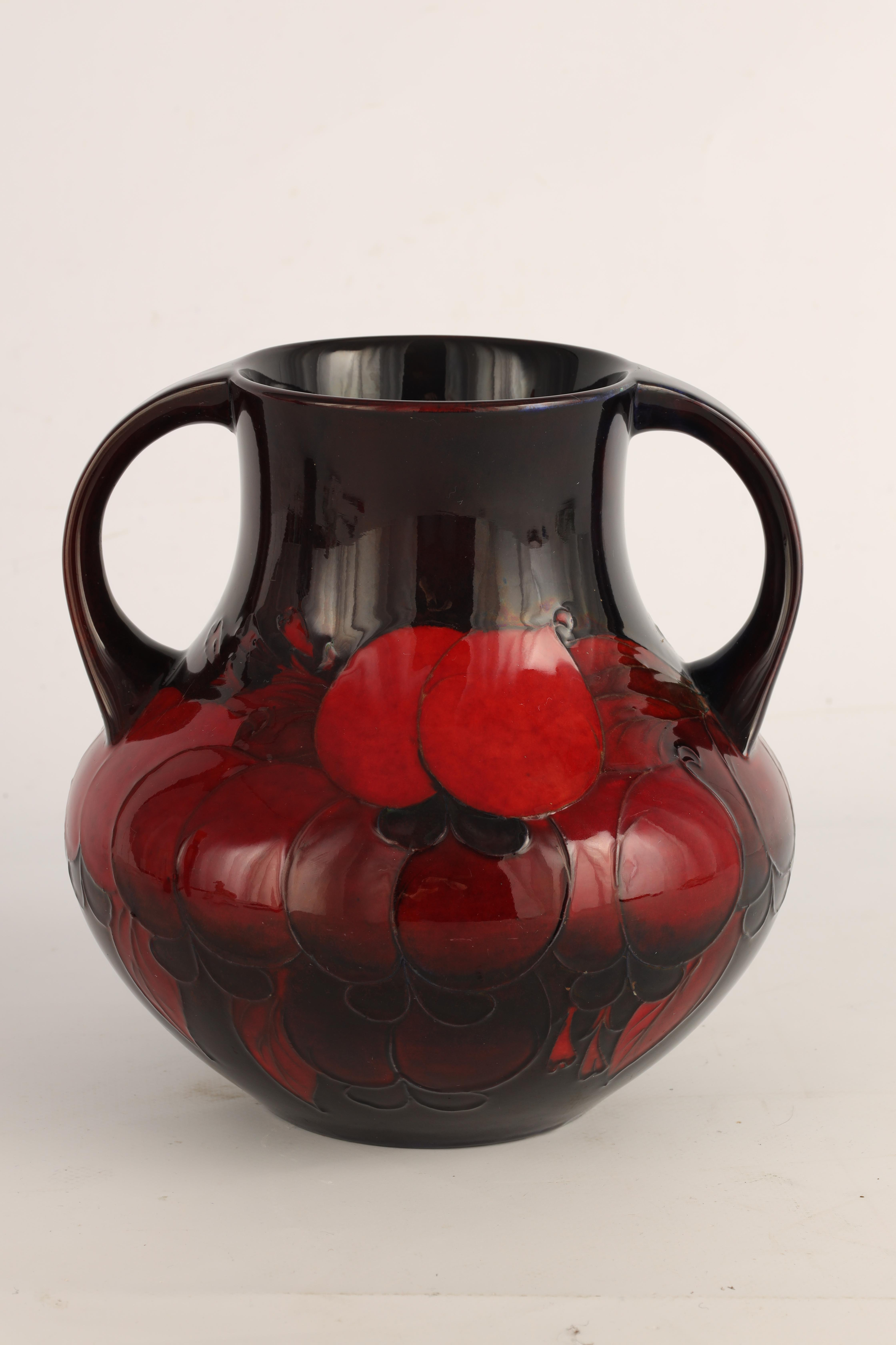 A 1930S/40S MOORCROFT LARGE TWO HANDLED BULBOUS VASE richly decorated all round in the Wisteria - Image 4 of 5