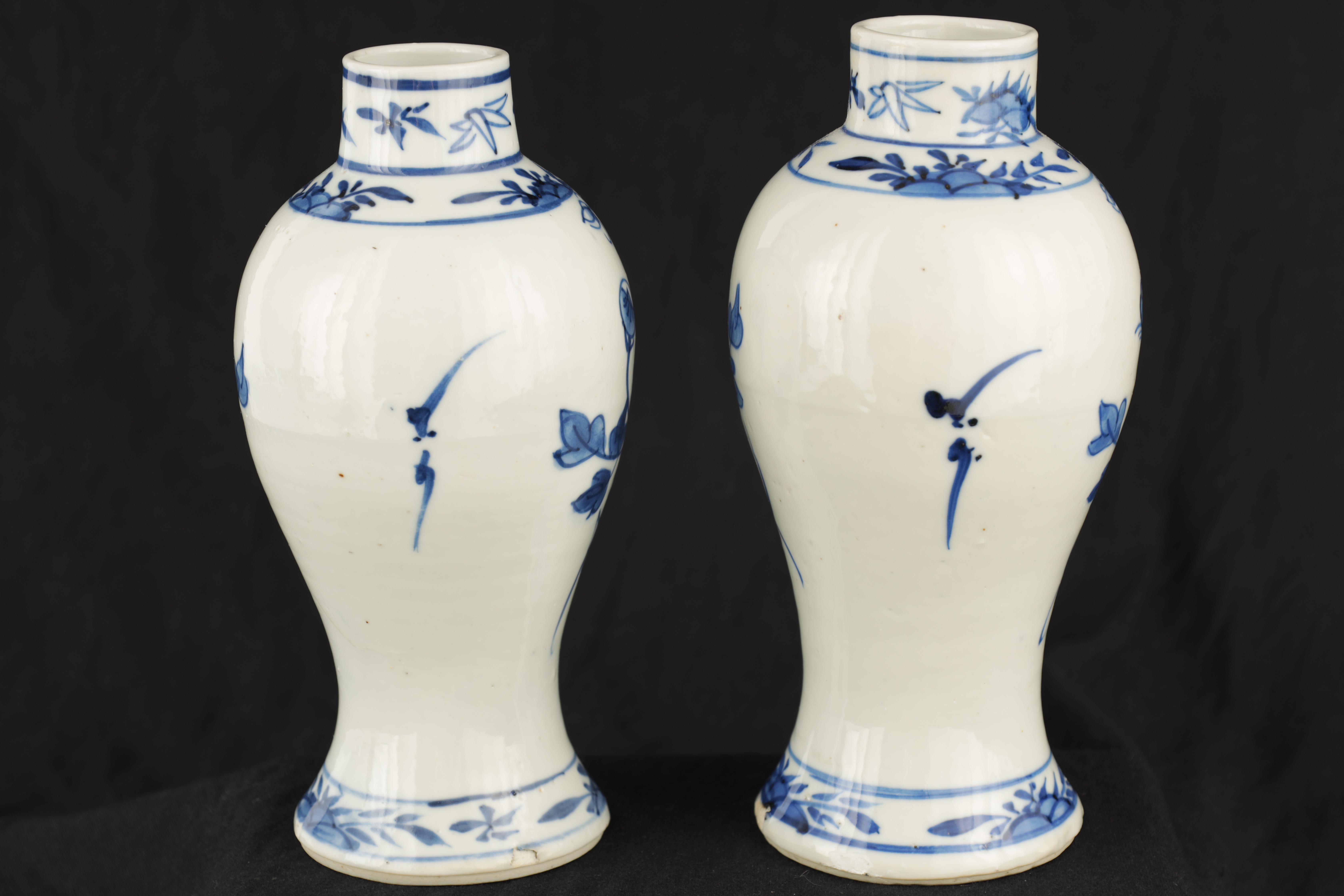 A PAIR OF 19TH CENTURY CHINESE BLUE AND WHITE VASES decorated with blossoming trees and birds 17cm - Image 7 of 9
