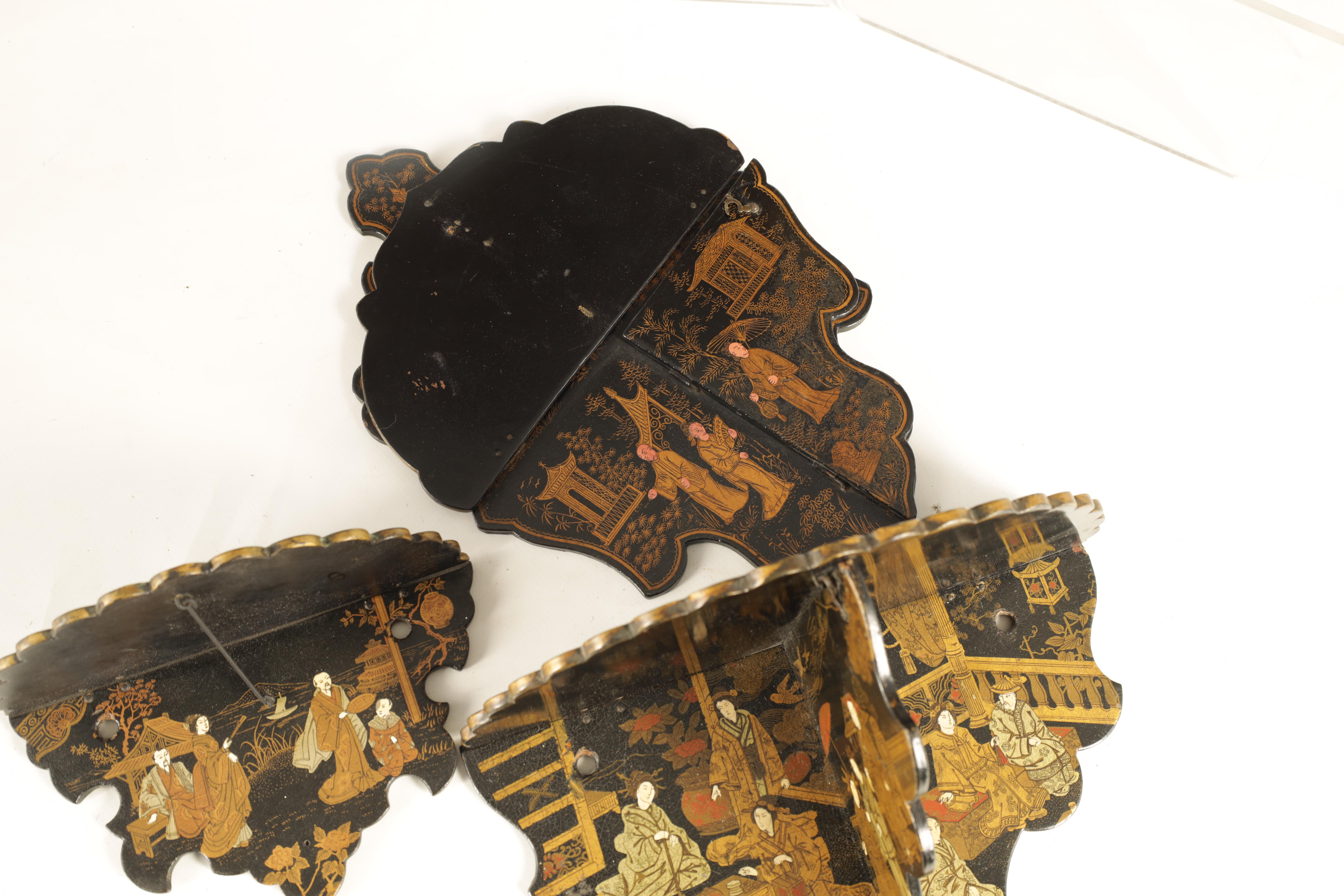 A GROUP OF THREE LATE 19TH CENTURY JAPANESE BLACK LACQUER FOLDING HANGING BRACKETS of shaped form - Image 12 of 12