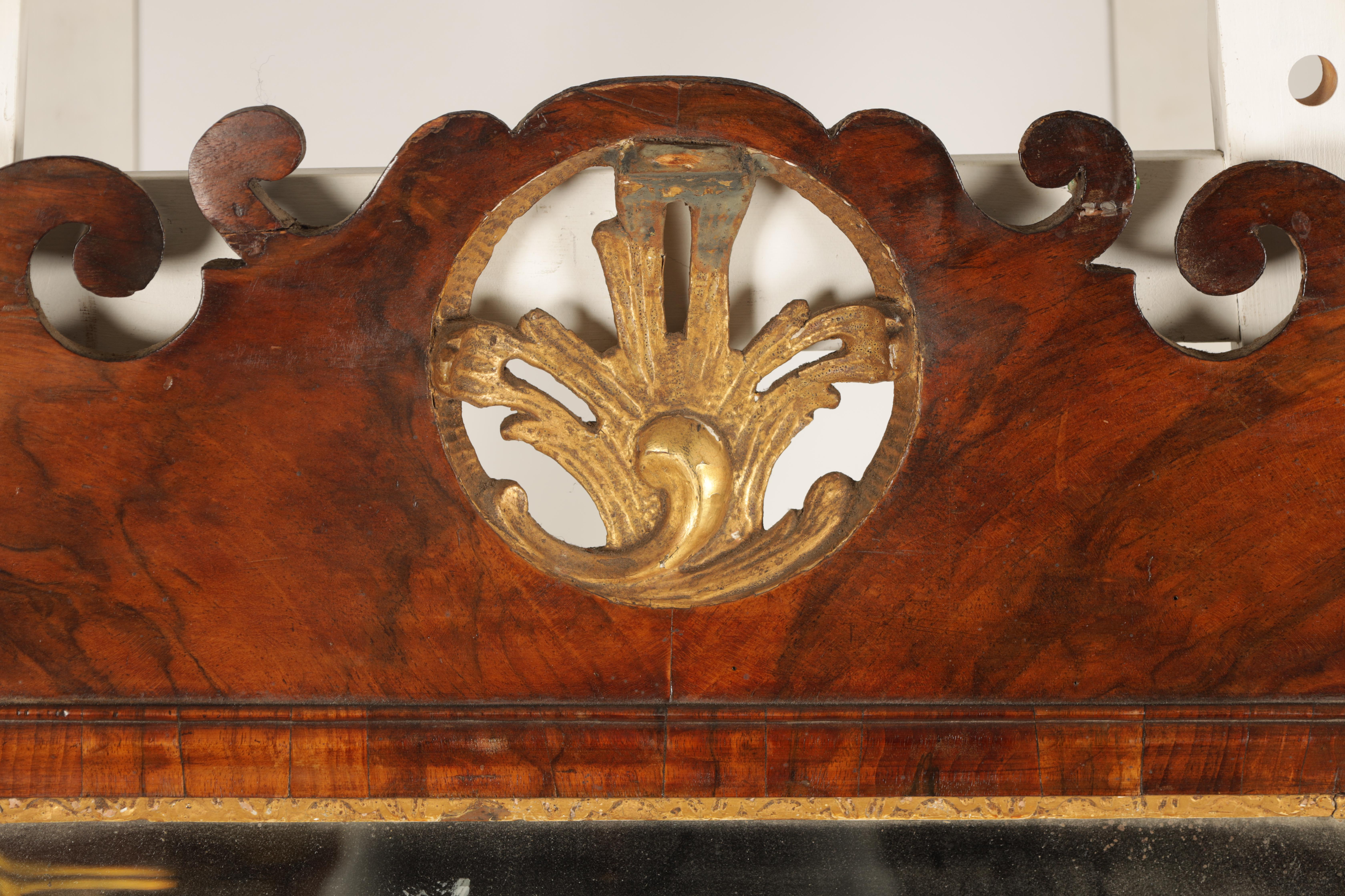 AN 18TH CENTURY WALNUT PIER MIRROR with shaped scrolled frame and gilt carved rococo pediment, the - Image 2 of 5