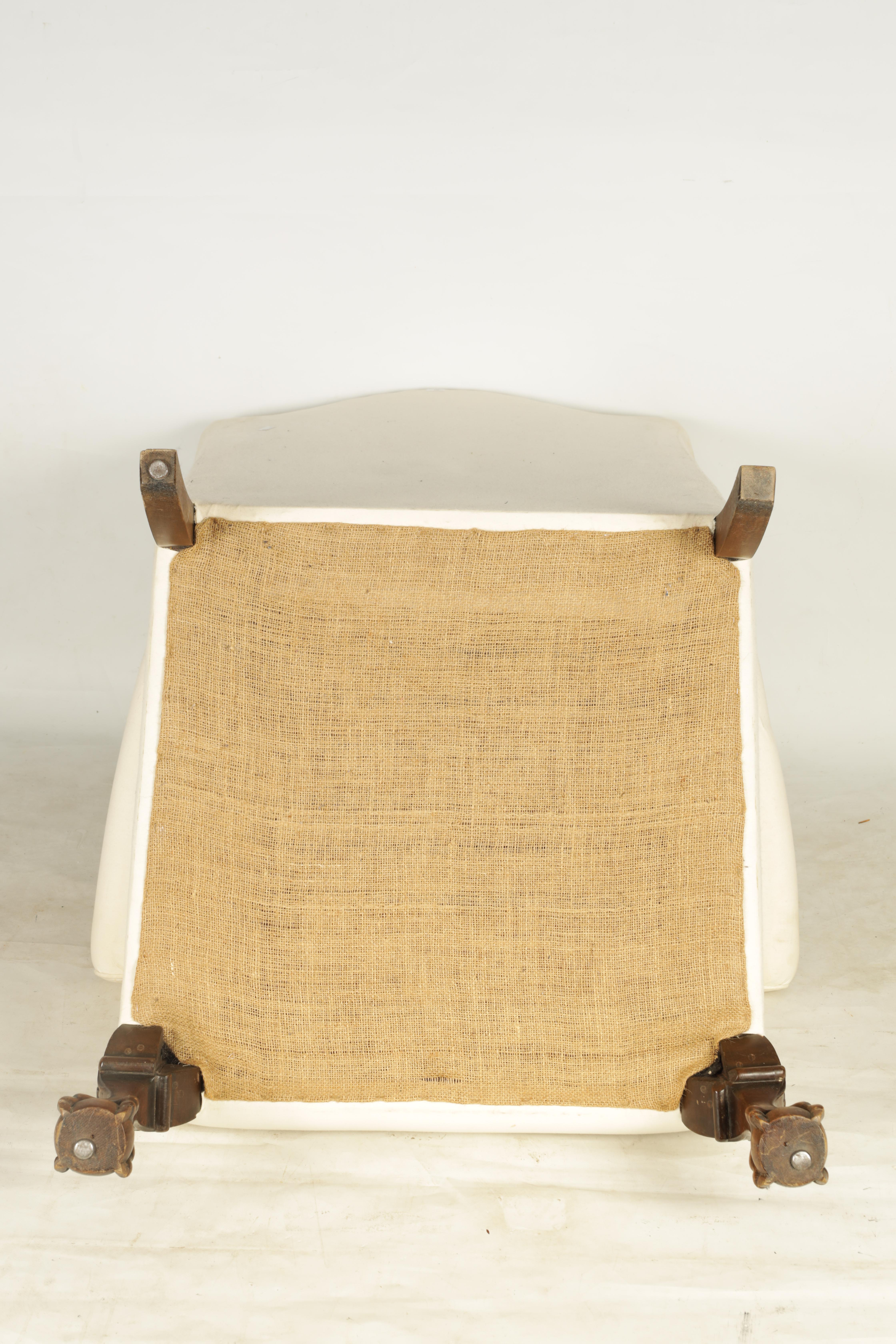 A LATE 19TH CENTURY GEORGE I STYLE WINGBACK UPHOLSTERED ARMCHAIR with mahogany leaf carved - Image 6 of 6