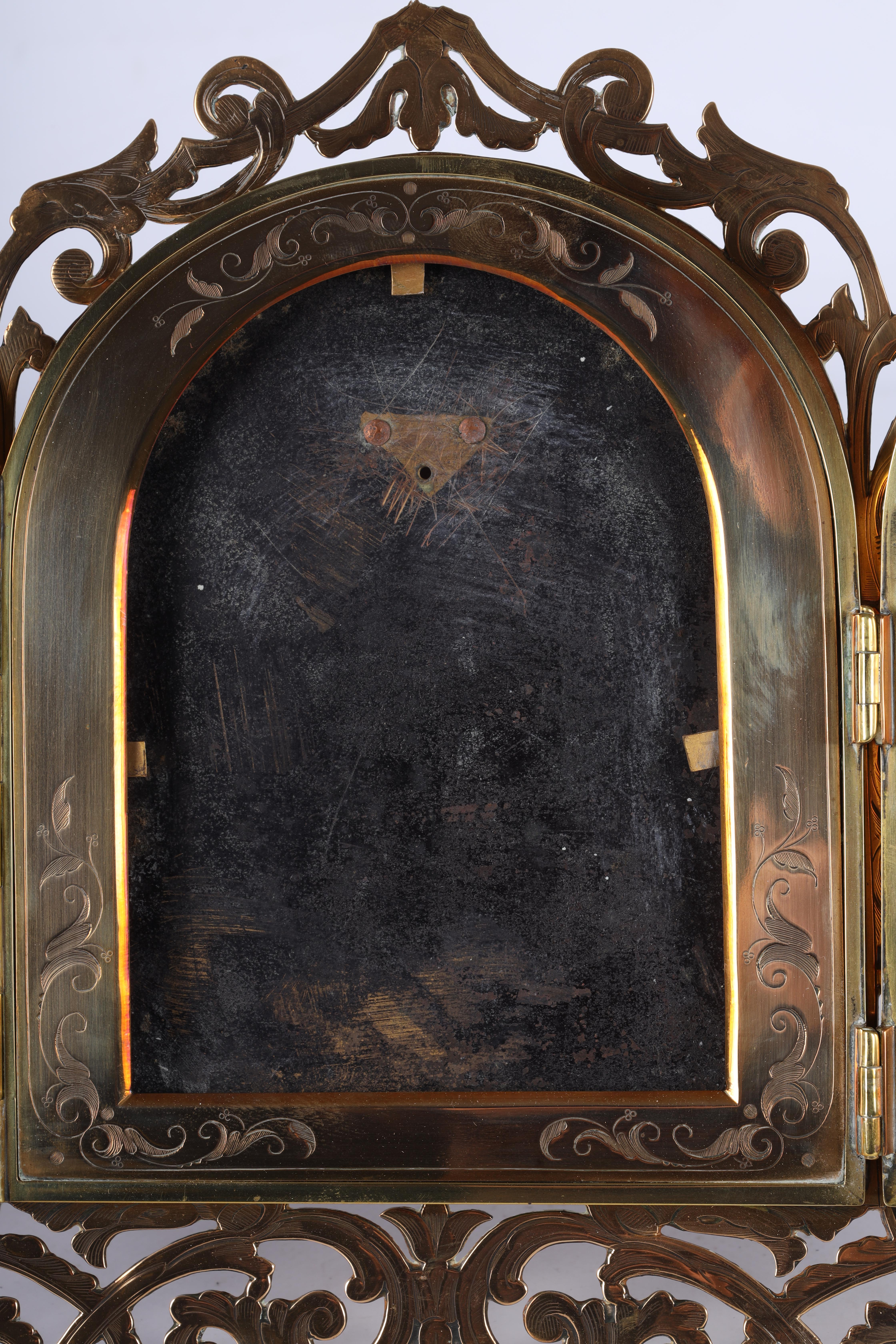A LATE 19TH CENTURY PIERCED AND ENGRAVED BRONZE FOLDING PHOTOGRAPH FRAME the front with four - Image 5 of 8