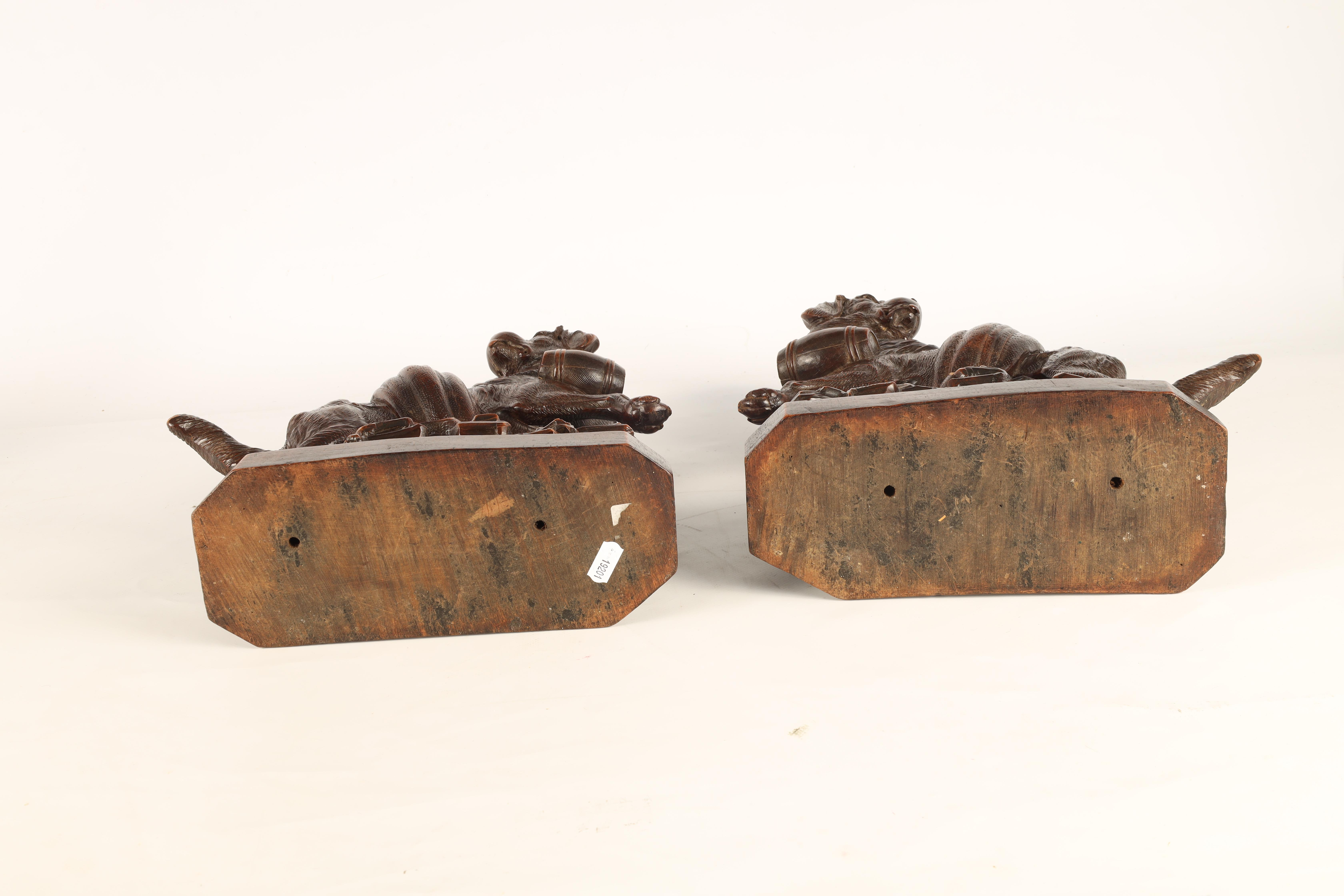 A GOOD QUALITY PAIR OF LATE 19TH CENTURY BLACK FOREST CARVED SCULPTURES modelled as Saint Bernards - Image 6 of 6