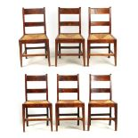 A SET OF SIX 19TH CENTURY COUNTRY FRUITWOOD DINING CHAIRS with rush seats and bar backs; standing on
