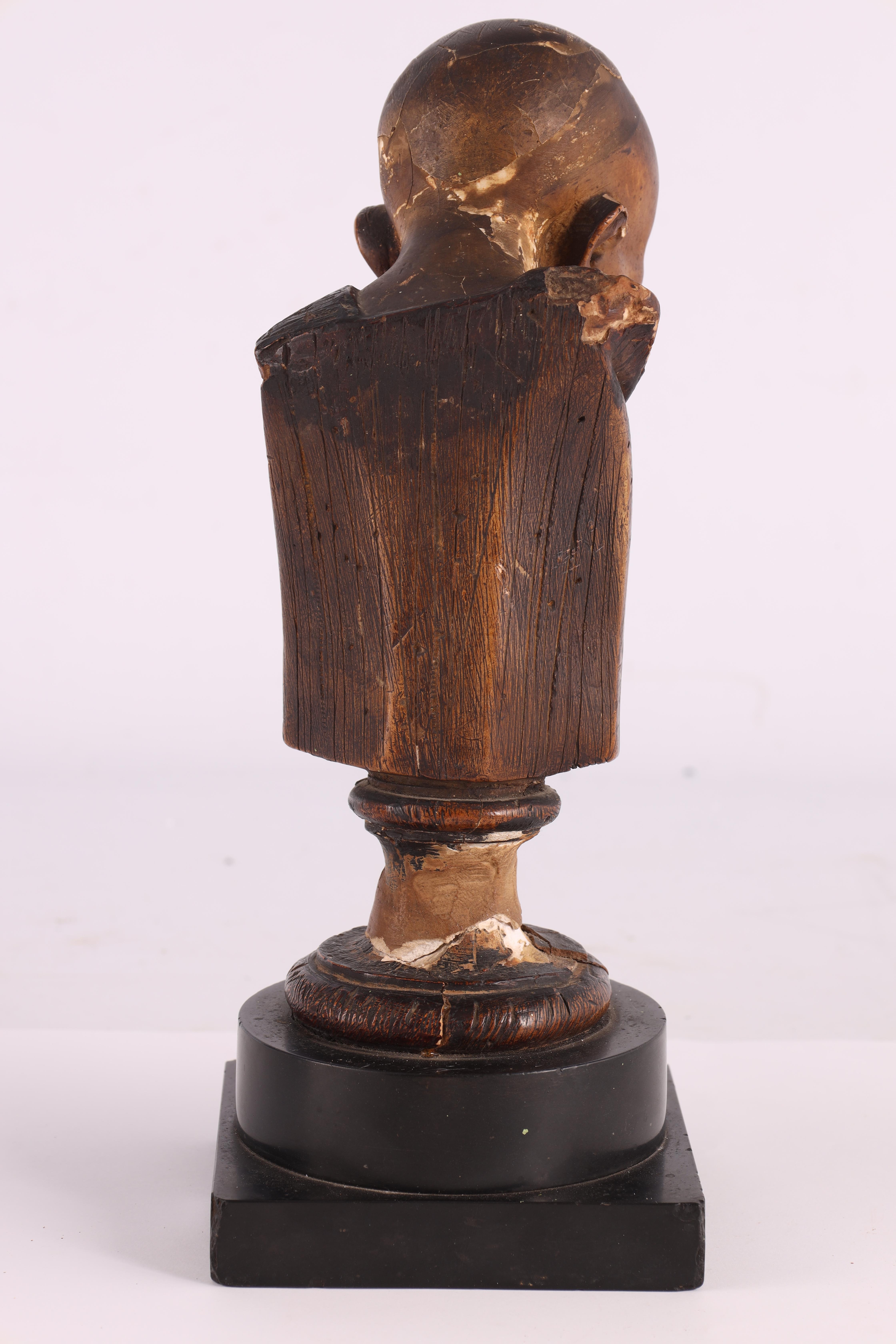 A 19TH CENTURY POLYCHROME PLASTER BUST modelled as a monk with blue eyes mounted on a black marble - Image 5 of 5