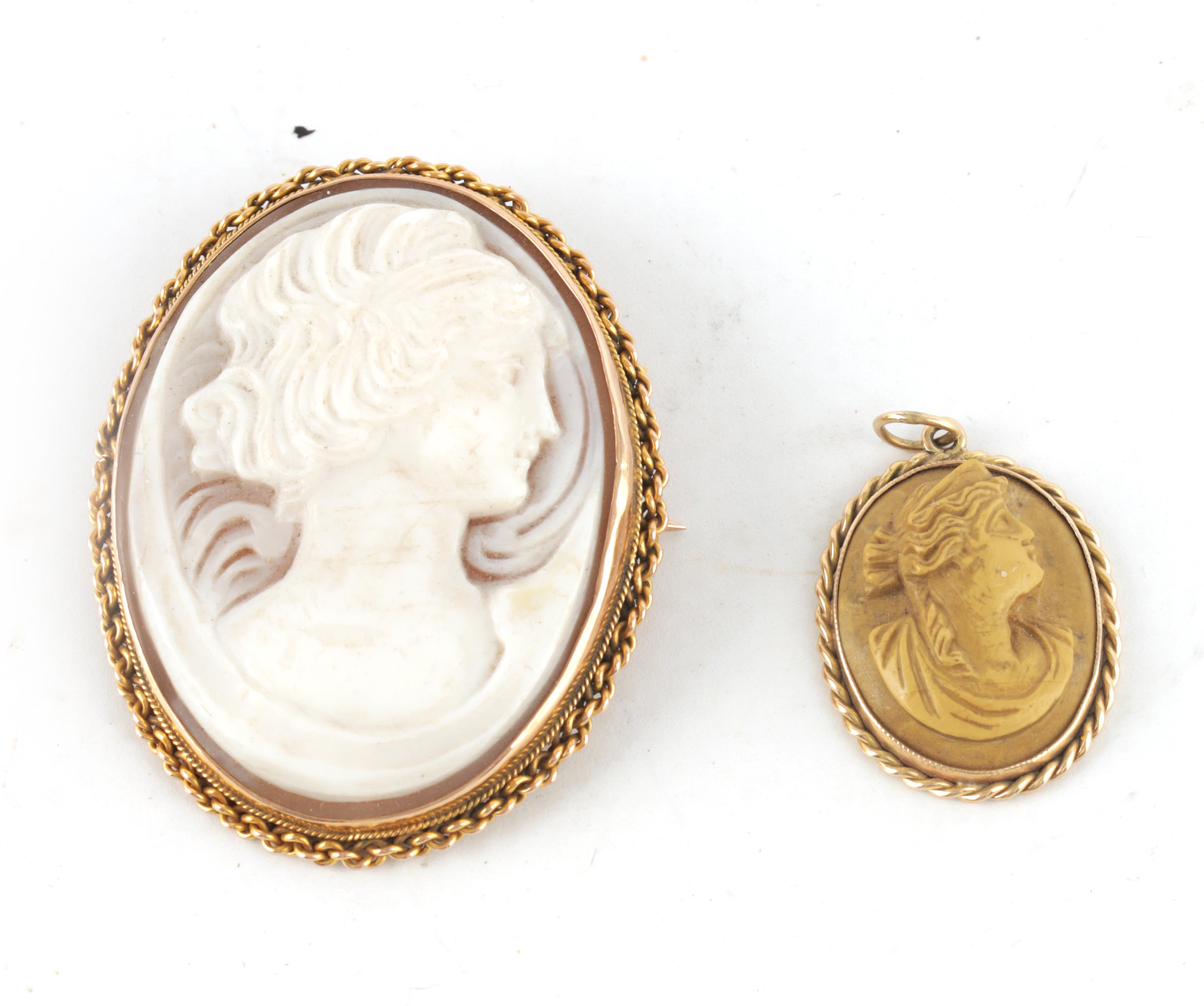 TWO LADIES GOLD FRAMED CAMEOS with finely carved portraits surrounded by rope twist frames 5cm