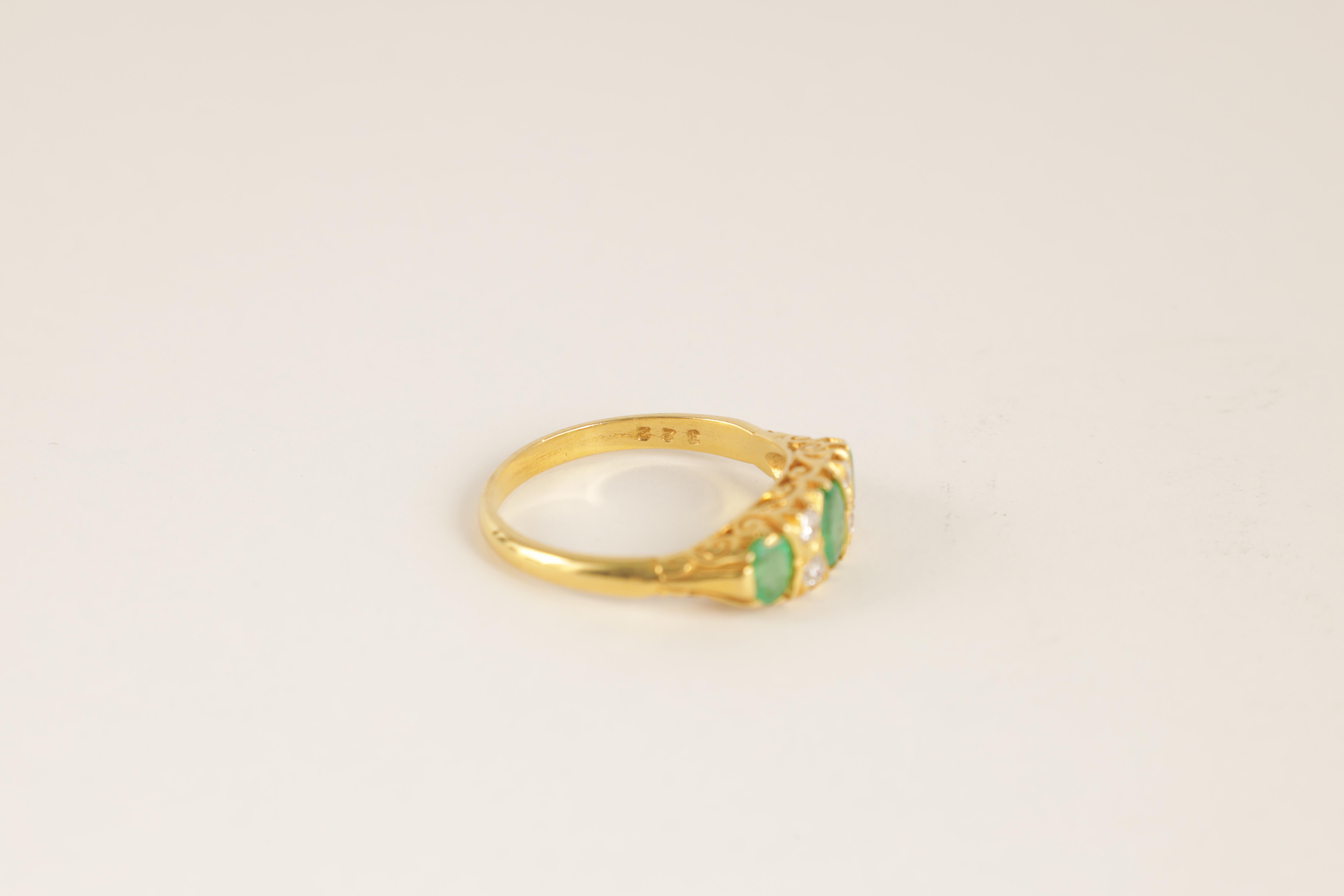 A LADIES 18CT GOLD DIAMOND AND EMERALD RING having four small diamonds set between three oval - Image 2 of 4