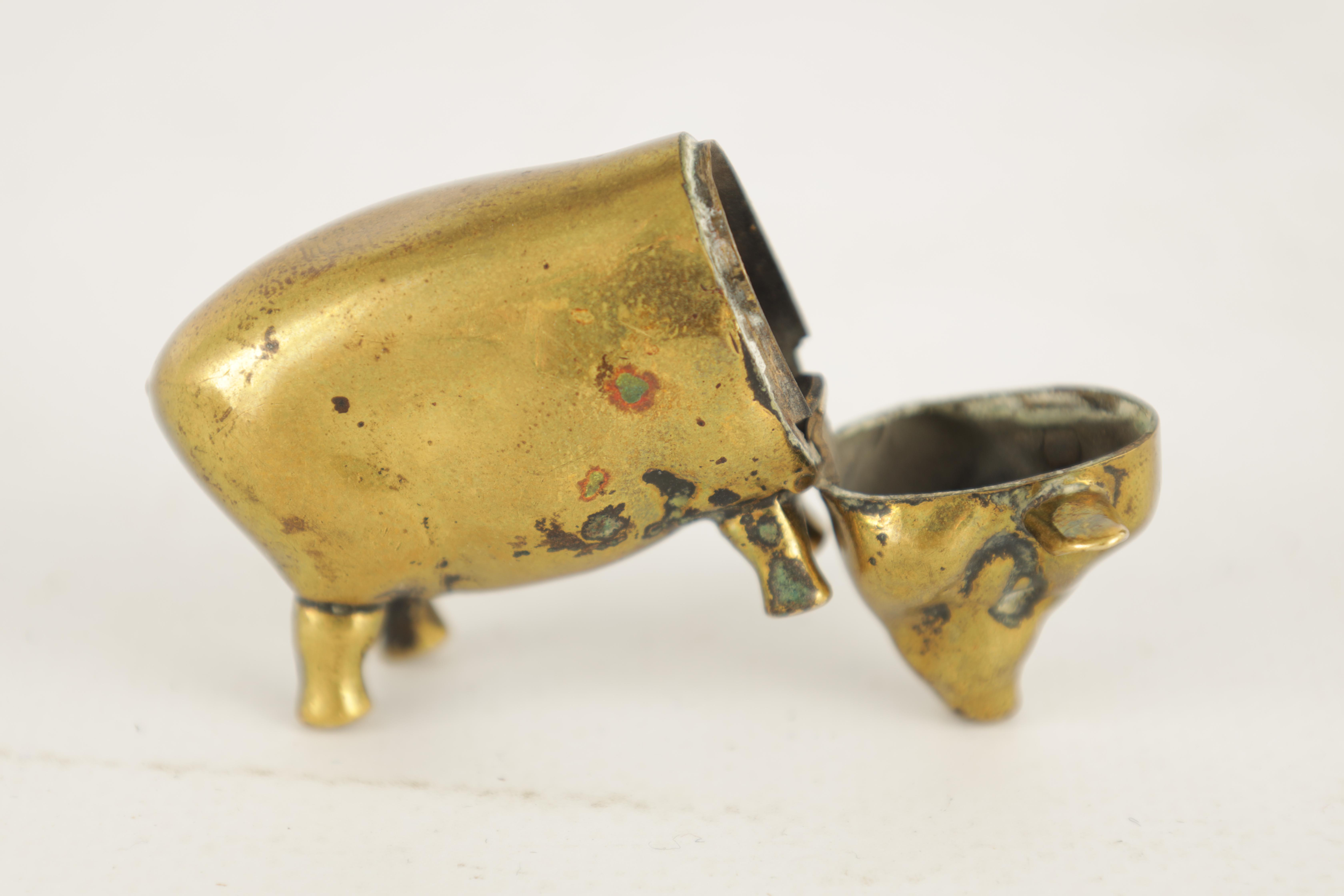 A 19TH CENTURY BRASS VESTA CASE FORMED AS A PIG with hinged head and striker to the belly 6cm wide - Image 6 of 6