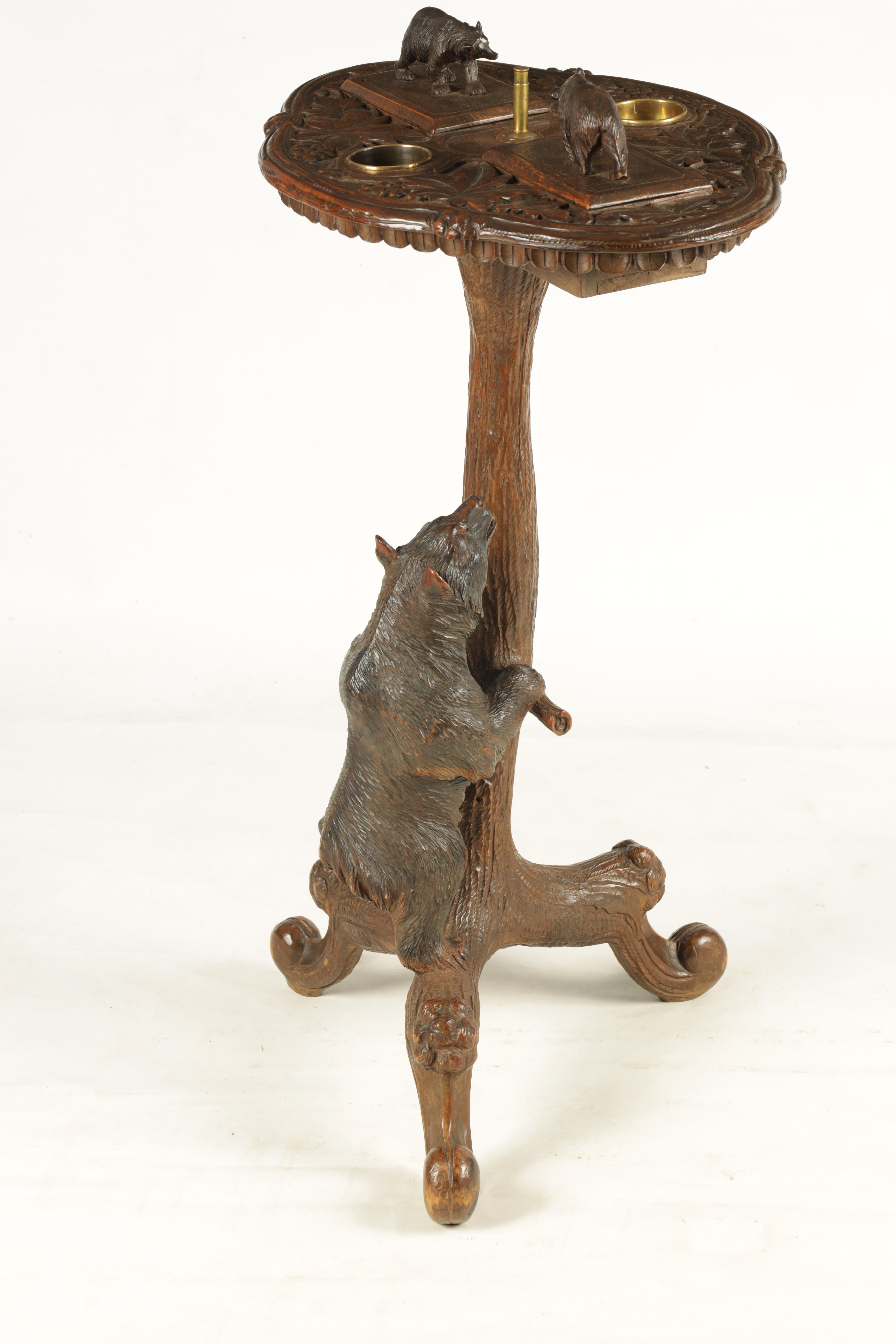 A LATE 19TH CENTURY SWISS CARVED BLACK FOREST SMOKERS TABLE with leaf carved top having two bear - Image 7 of 9