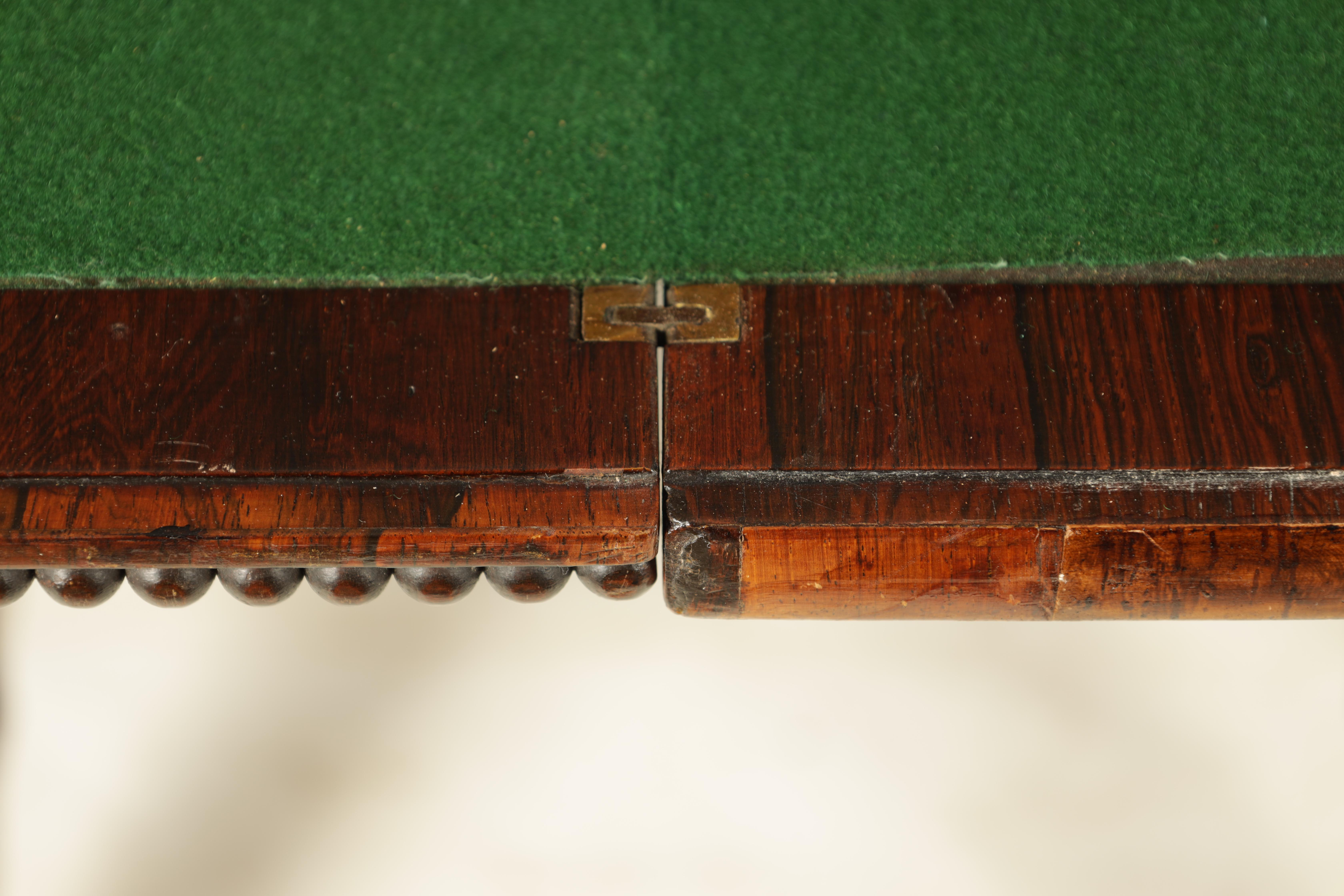 A REGENCY FIGURED ROSEWOOD CARD TABLE IN THE MANNER OF T & G SEDDON with revolving top revealing a - Image 4 of 9