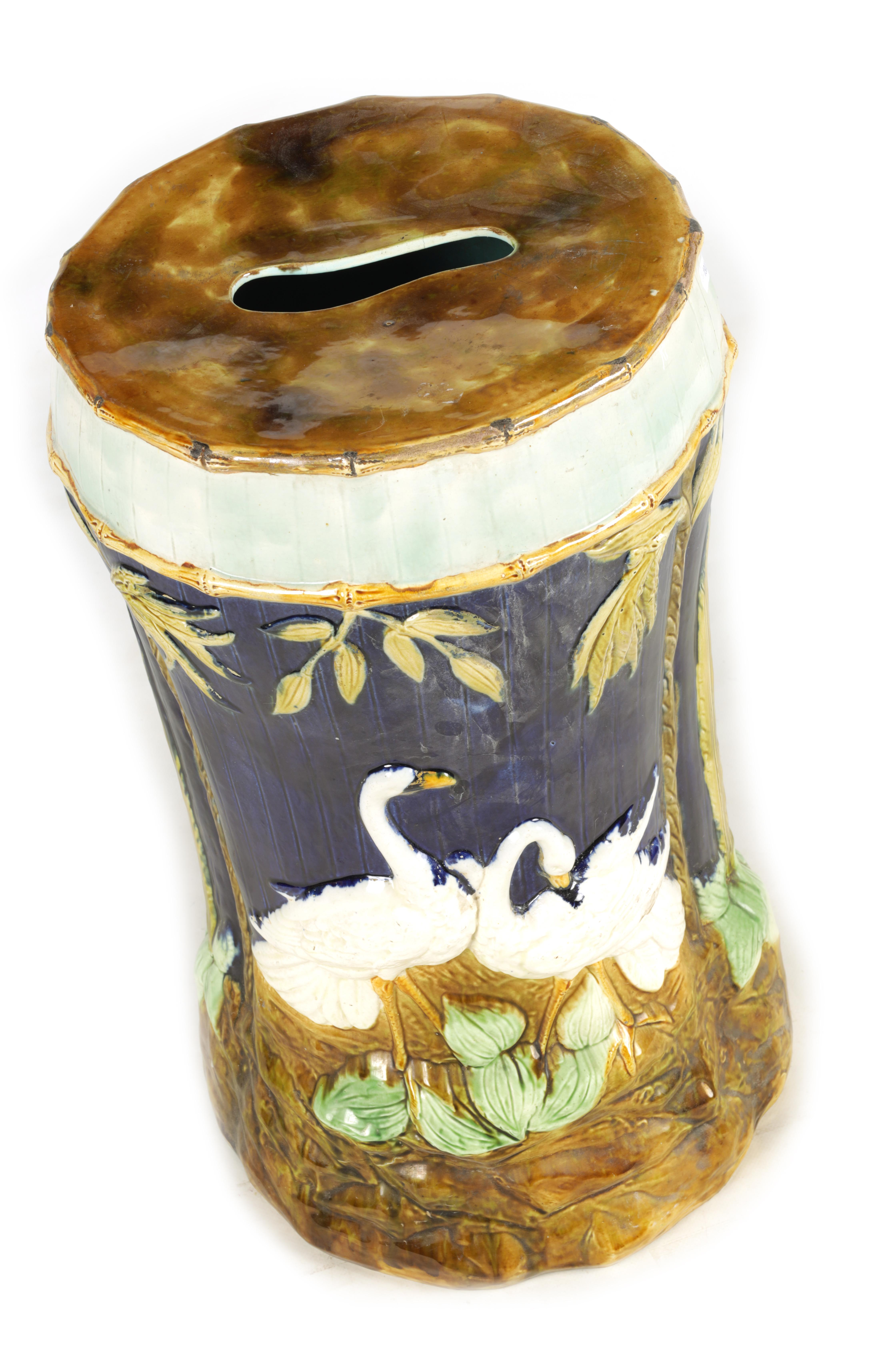 A LATE 19TH CENTURY MAJOLICA GARDEN SEAT decorated with storks between palm trees 54cm high - Image 2 of 8