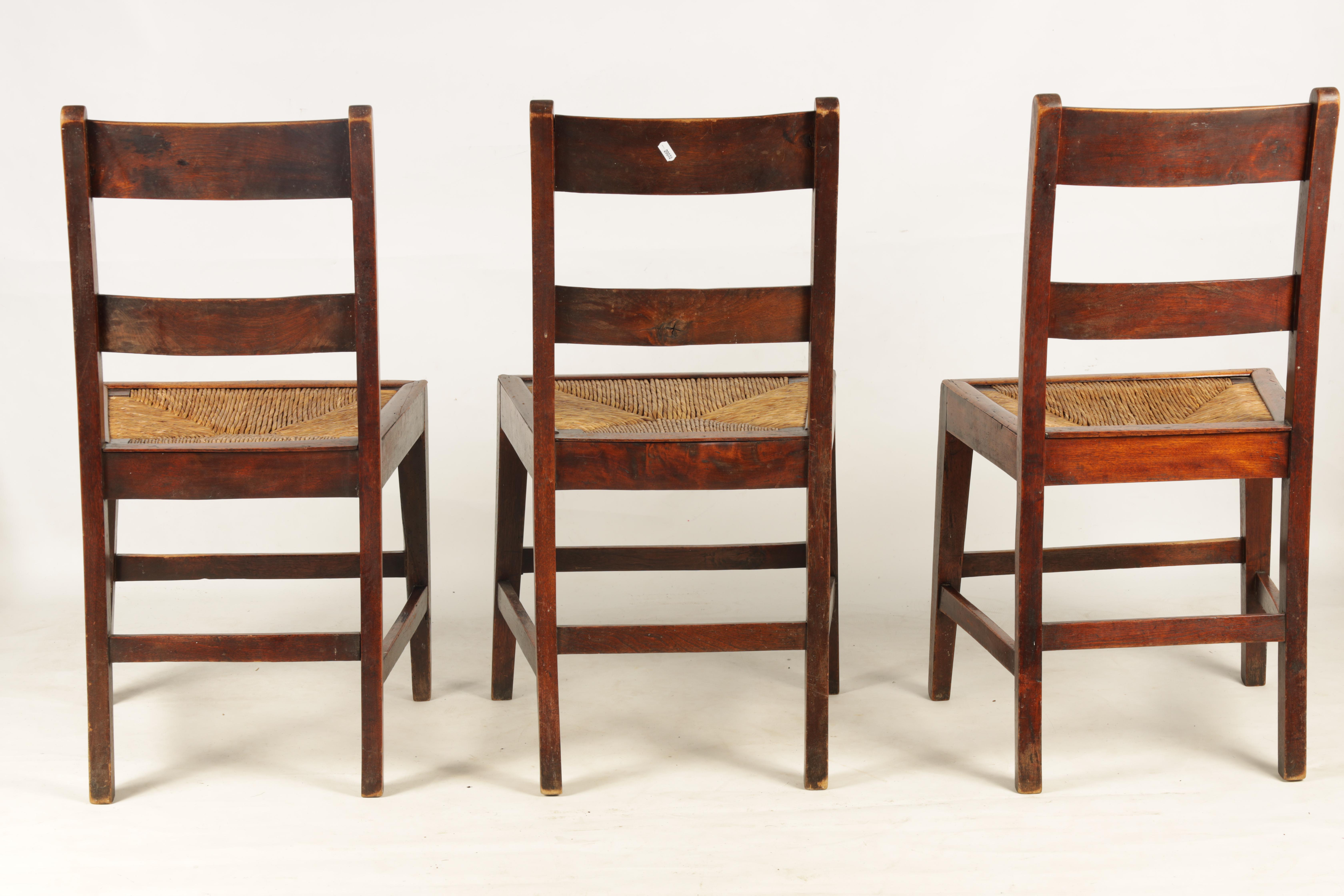 A SET OF SIX 19TH CENTURY COUNTRY FRUITWOOD DINING CHAIRS with rush seats and bar backs; standing on - Image 4 of 9