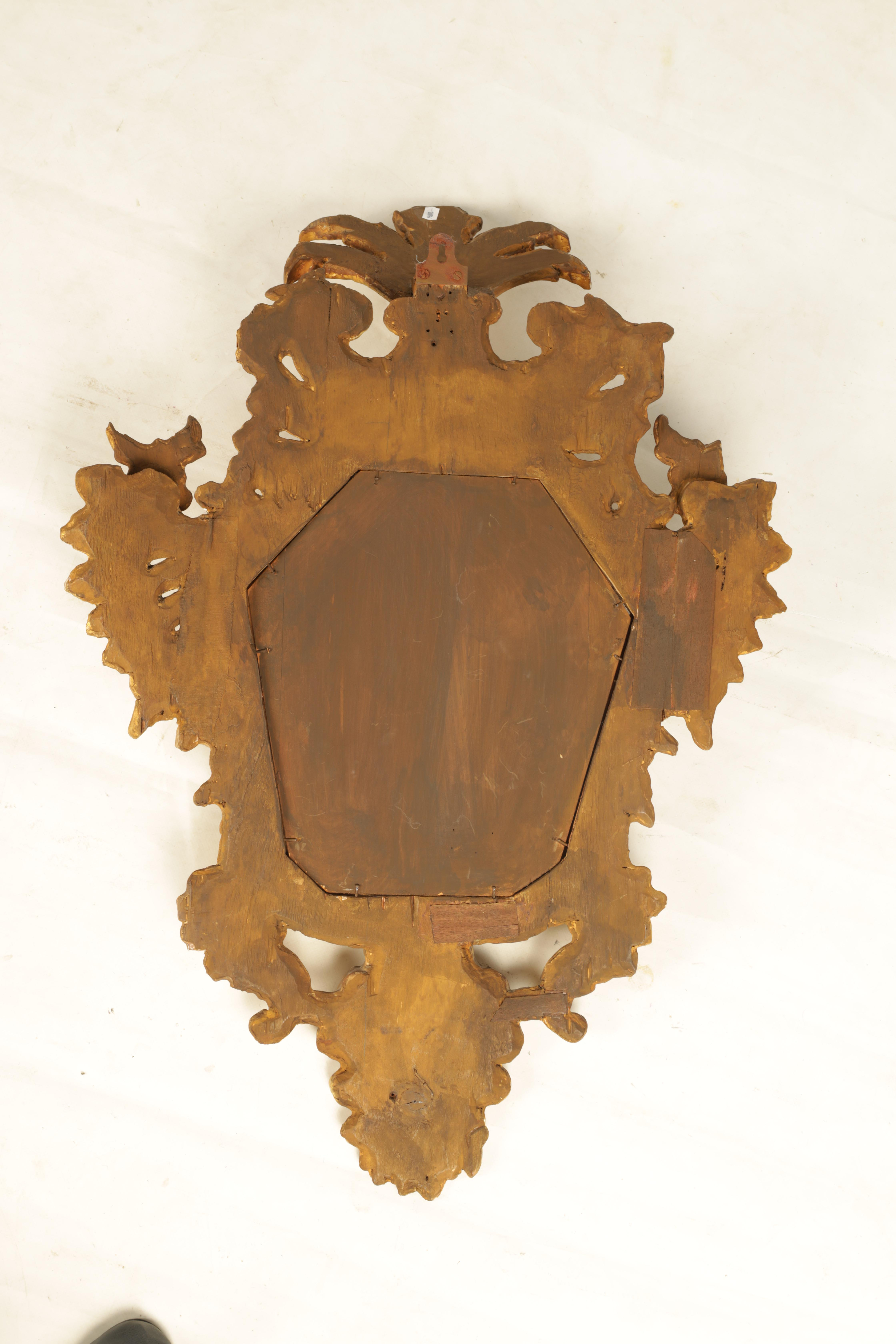 A PAIR OF 19TH CENTURY CARVED GILT WOOD ITALIAN FLORENTINE MIRRORS with leaf and shell carved frames - Image 8 of 8