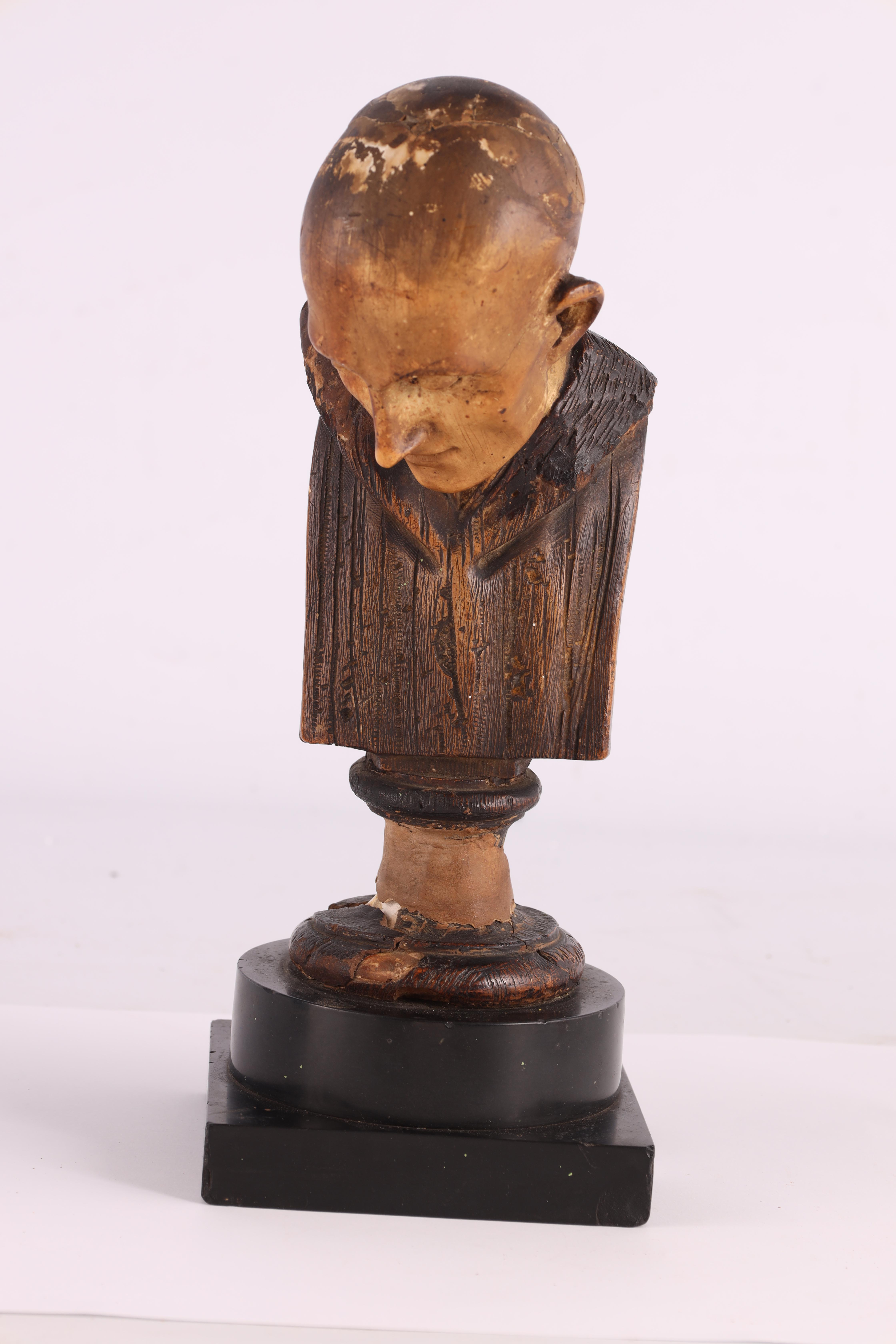 A 19TH CENTURY POLYCHROME PLASTER BUST modelled as a monk with blue eyes mounted on a black marble - Image 4 of 5