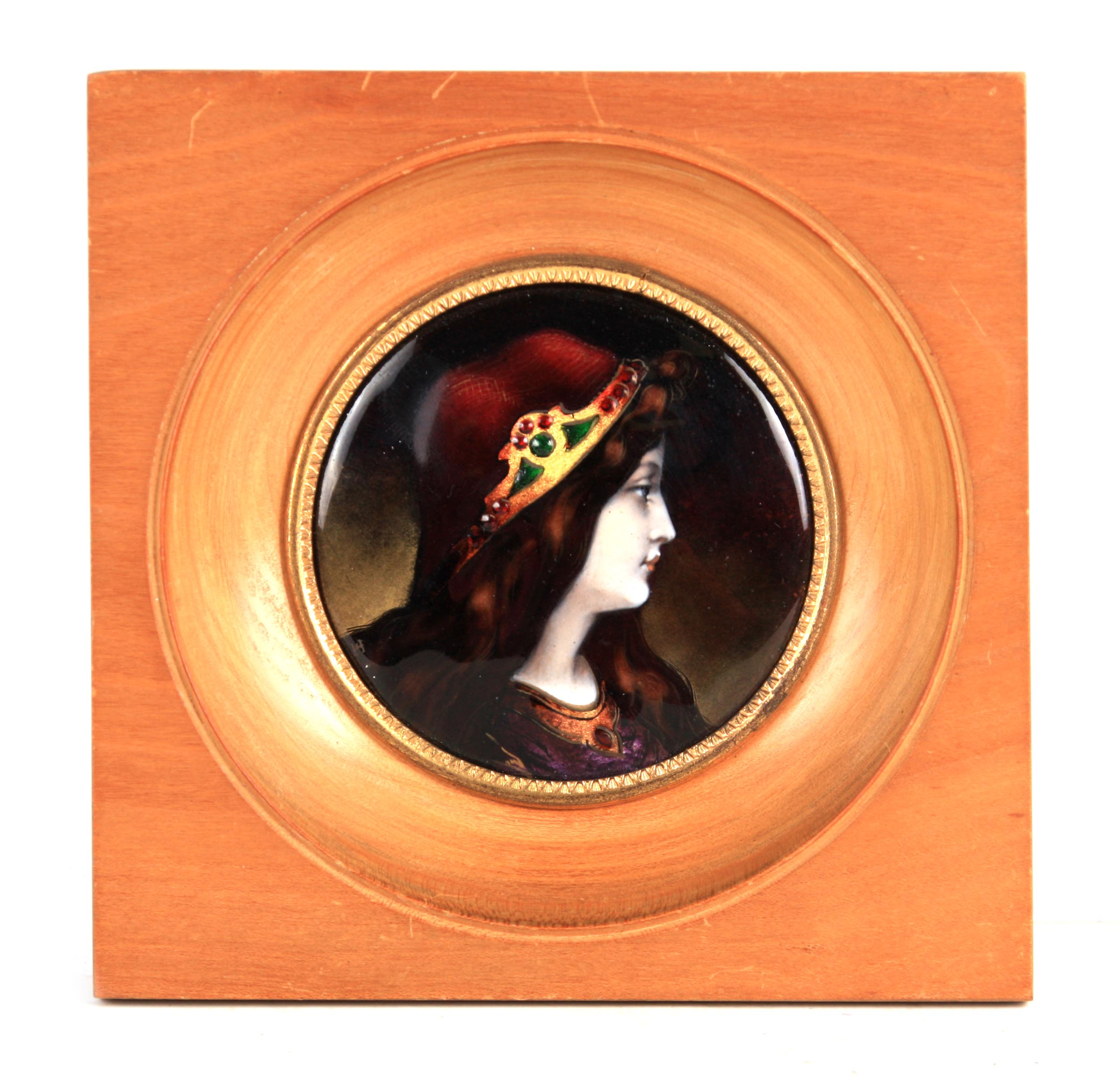 A PRE RAPHAELITE STYLE EARLY 20TH CENTURY LIMOGES ENAMEL CONVEX PANEL depicting the portrait of a