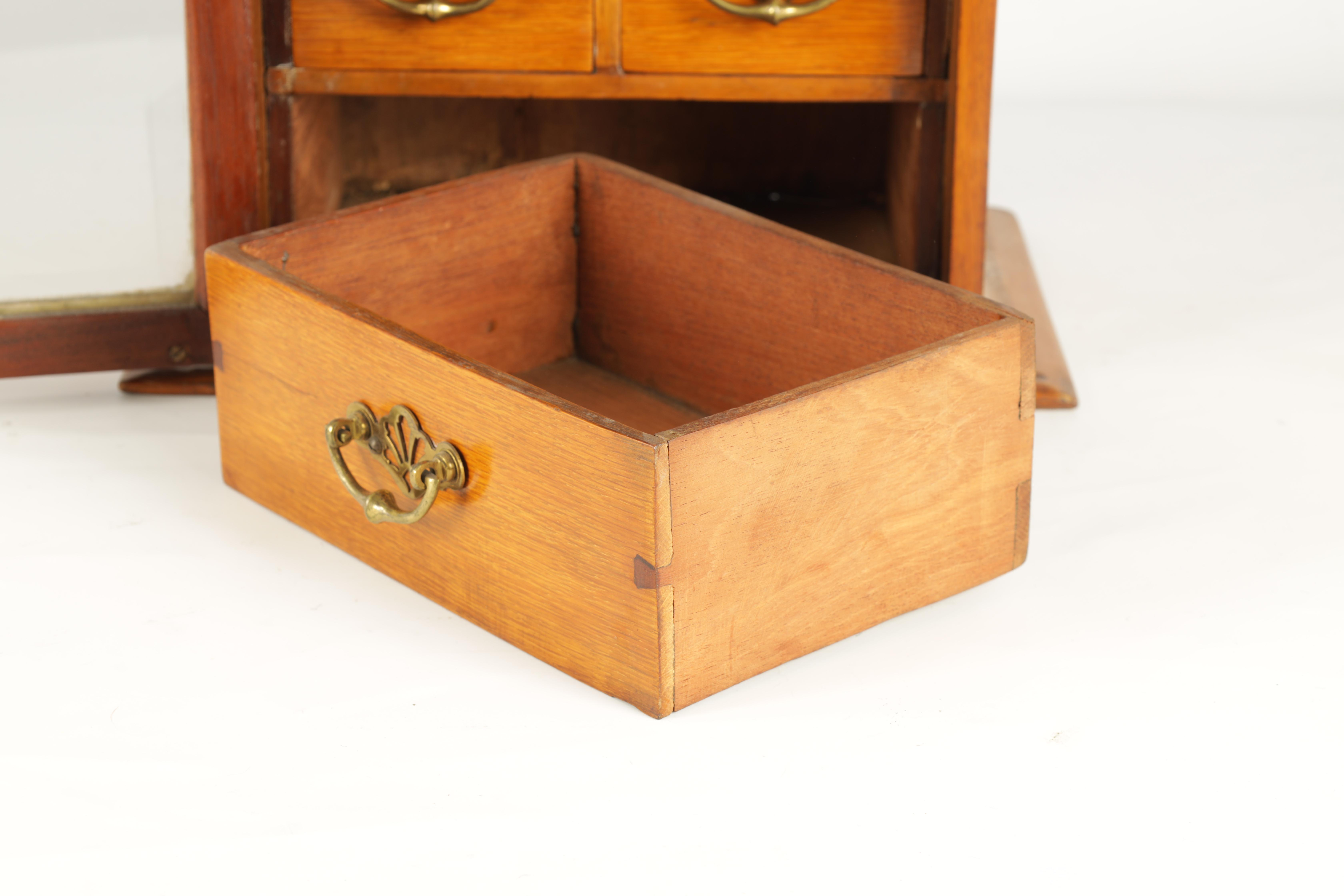 A STYLISH EDWARDIAN OAK SMOKERS CABINET with glazed door enclosing a shelved three drawer interior - Image 7 of 11