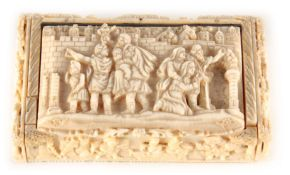 A 19TH CENTURY CONTINENTAL CARVED IVORY SNUFF BOX finely carved with mythological scenes, interior
