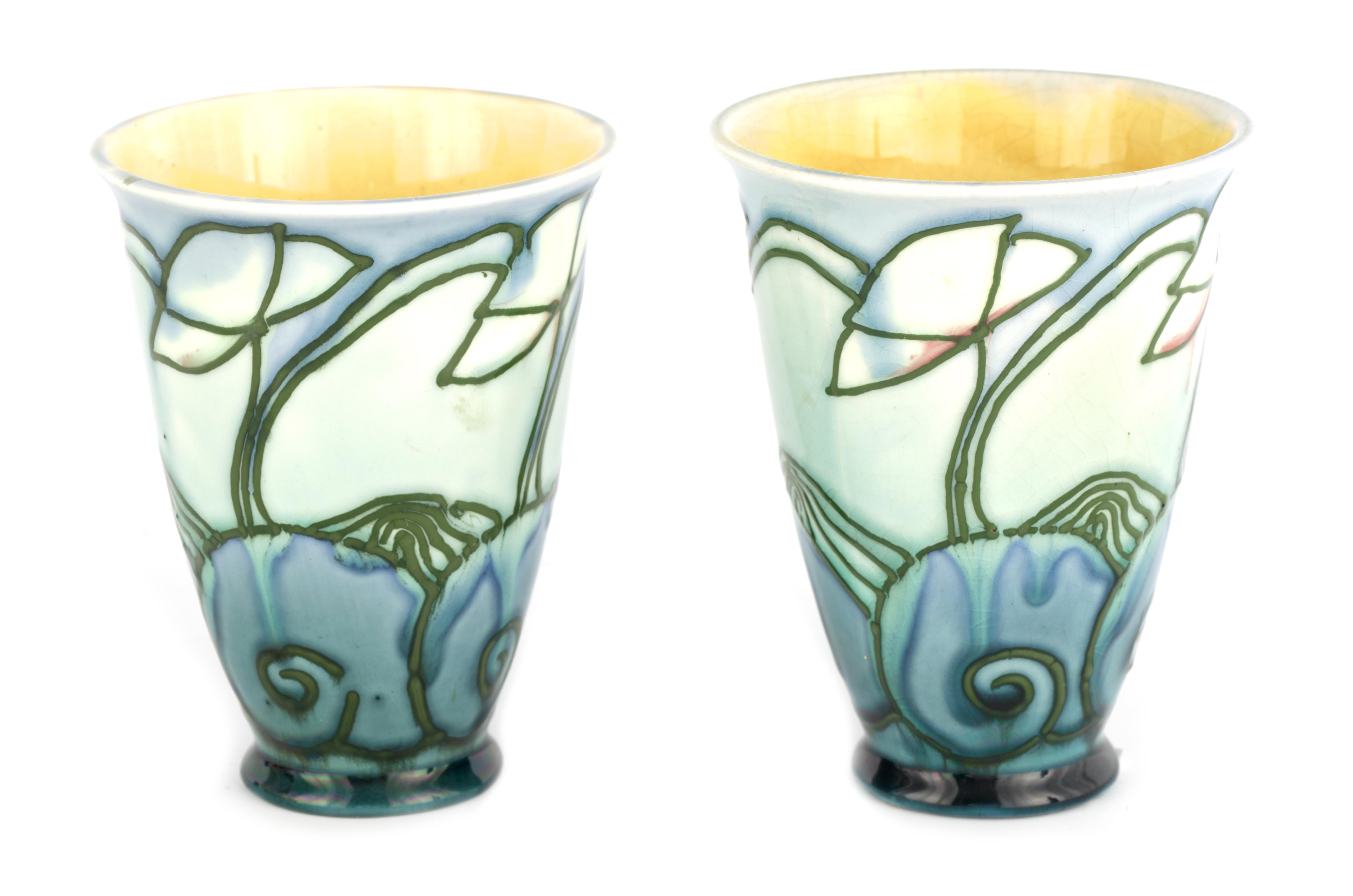 A PAIR OF MINTON LTD SECESSIONIST WARE TAPERING BEAKER VASES tube lined and decorated with