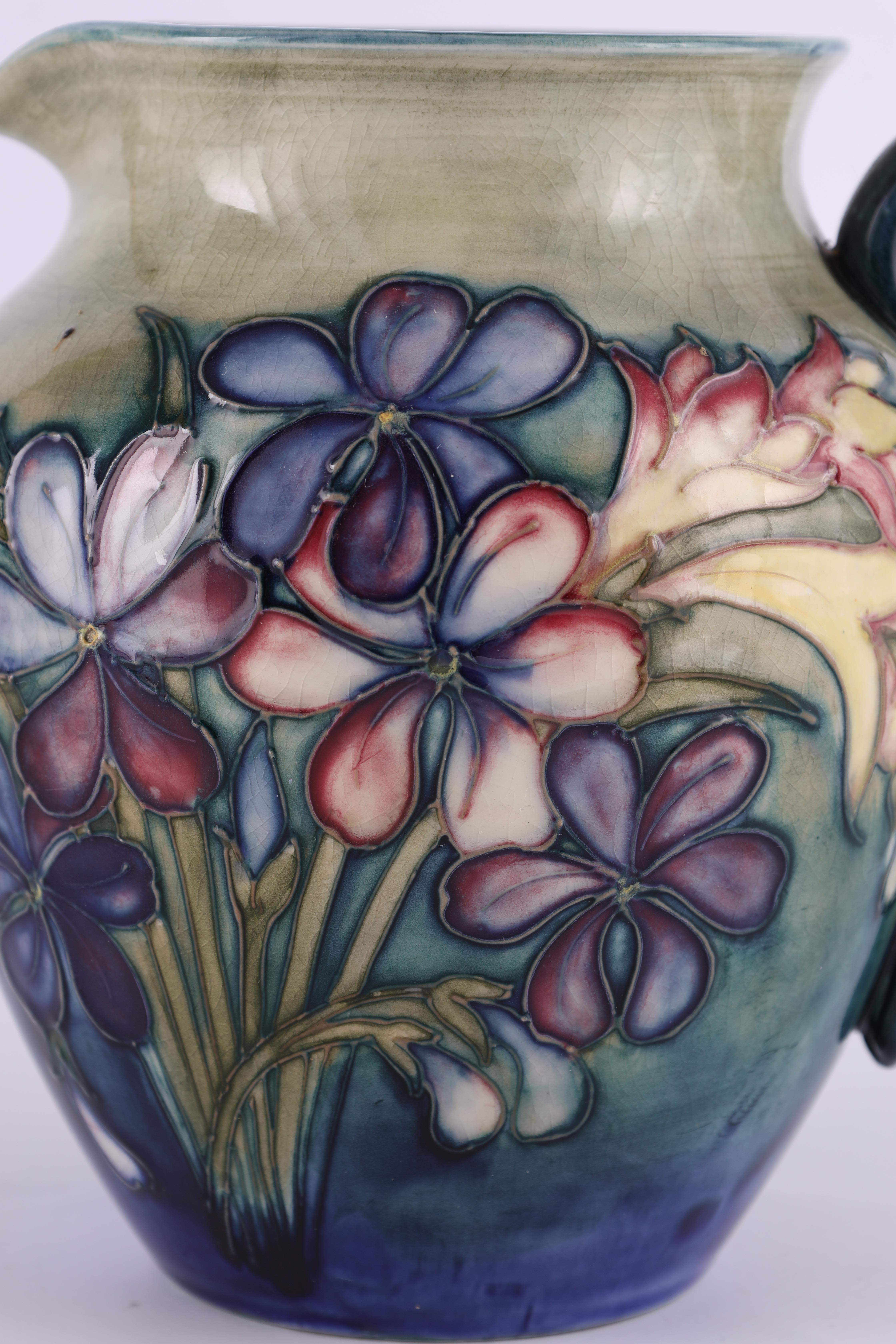 A MOORCROFT SHOULDERED TAPERING JUG tube lined and decorated in the spring flowers pattern on a - Image 3 of 6