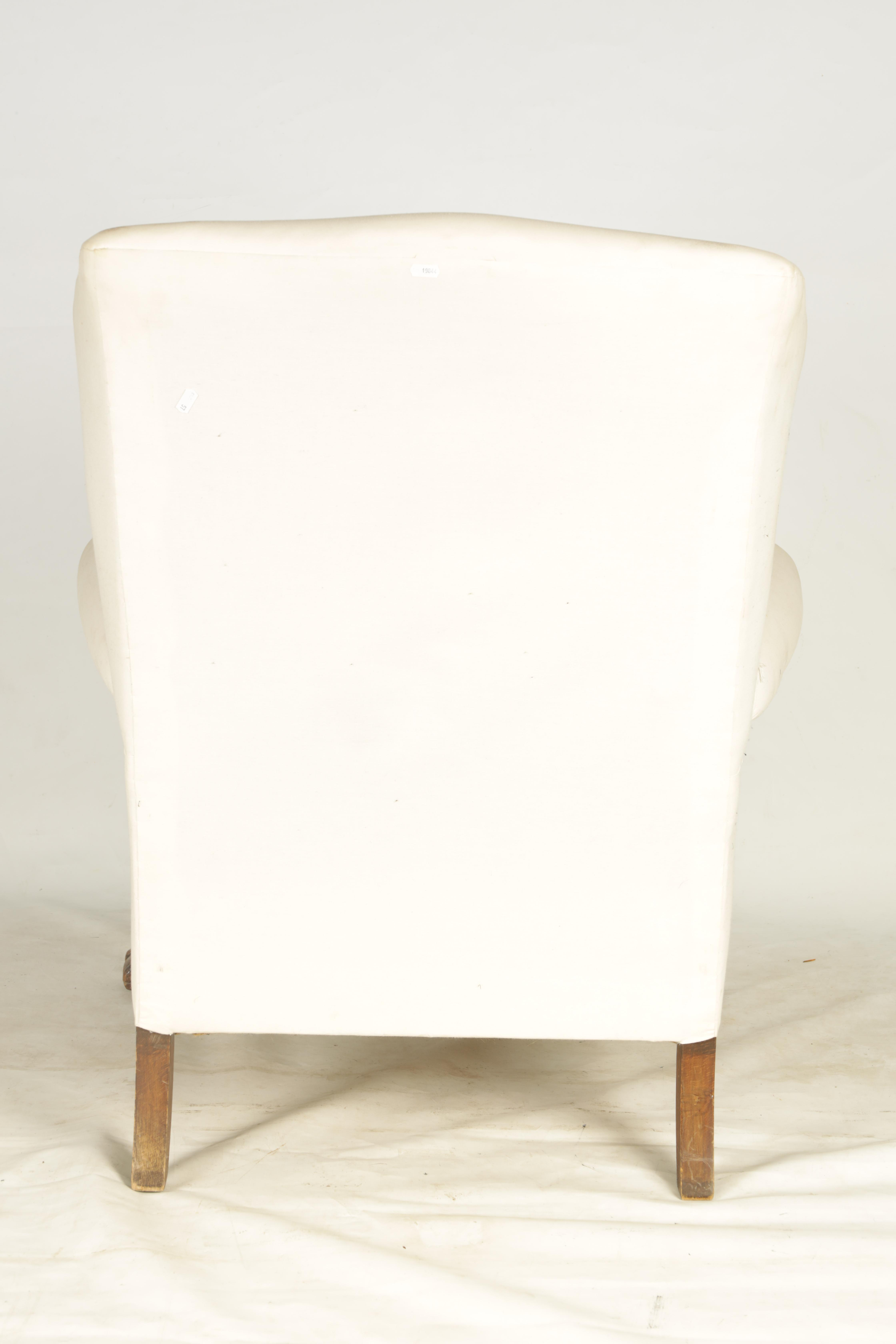 A LATE 19TH CENTURY GEORGE I STYLE WINGBACK UPHOLSTERED ARMCHAIR with mahogany leaf carved - Image 5 of 6