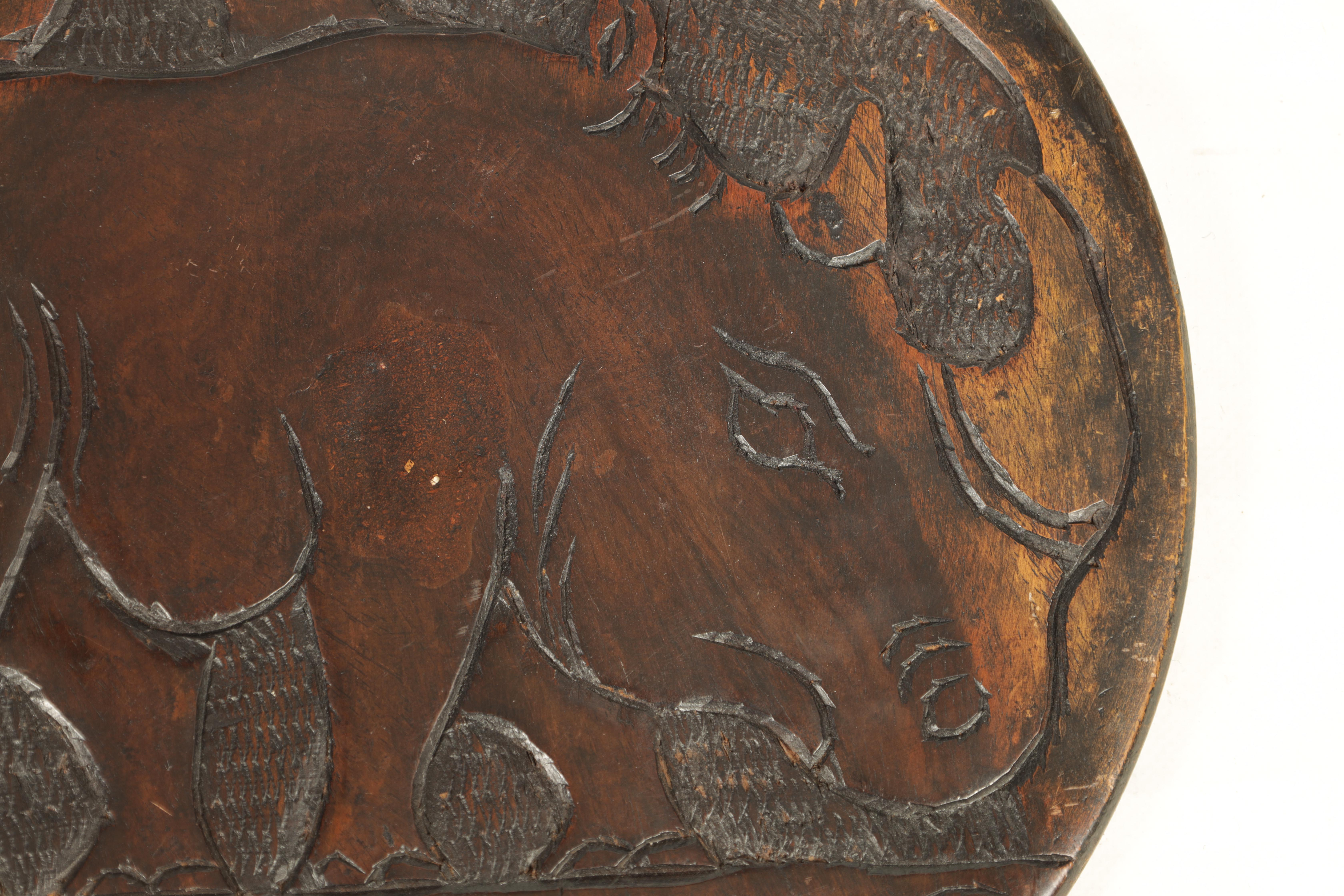 A LATE 19TH CENTURY AFRICAN HARDWOOD FOLDING TABLE the circular top relief carved with Rhinosorus - Image 6 of 7