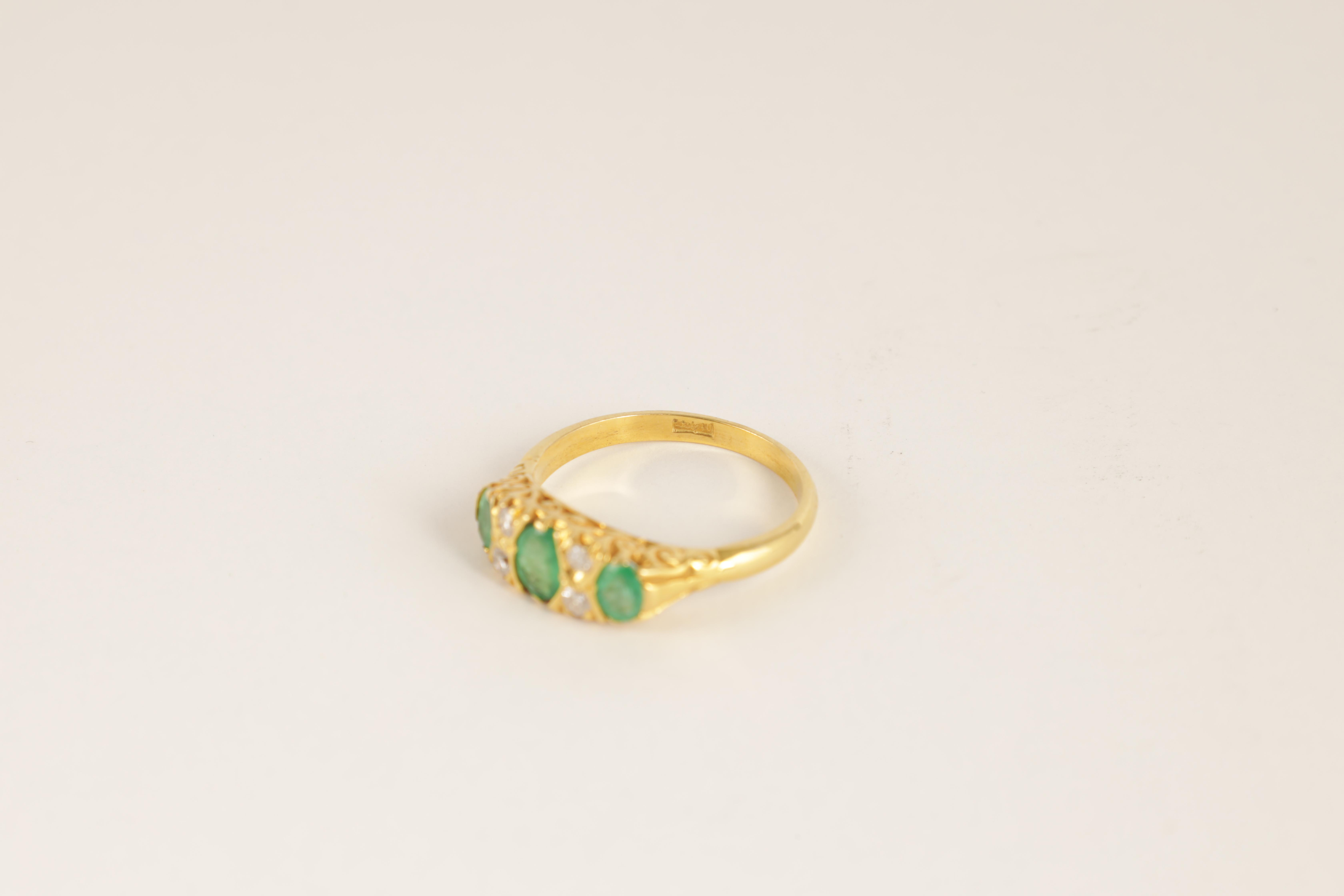 A LADIES 18CT GOLD DIAMOND AND EMERALD RING having four small diamonds set between three oval - Image 3 of 4