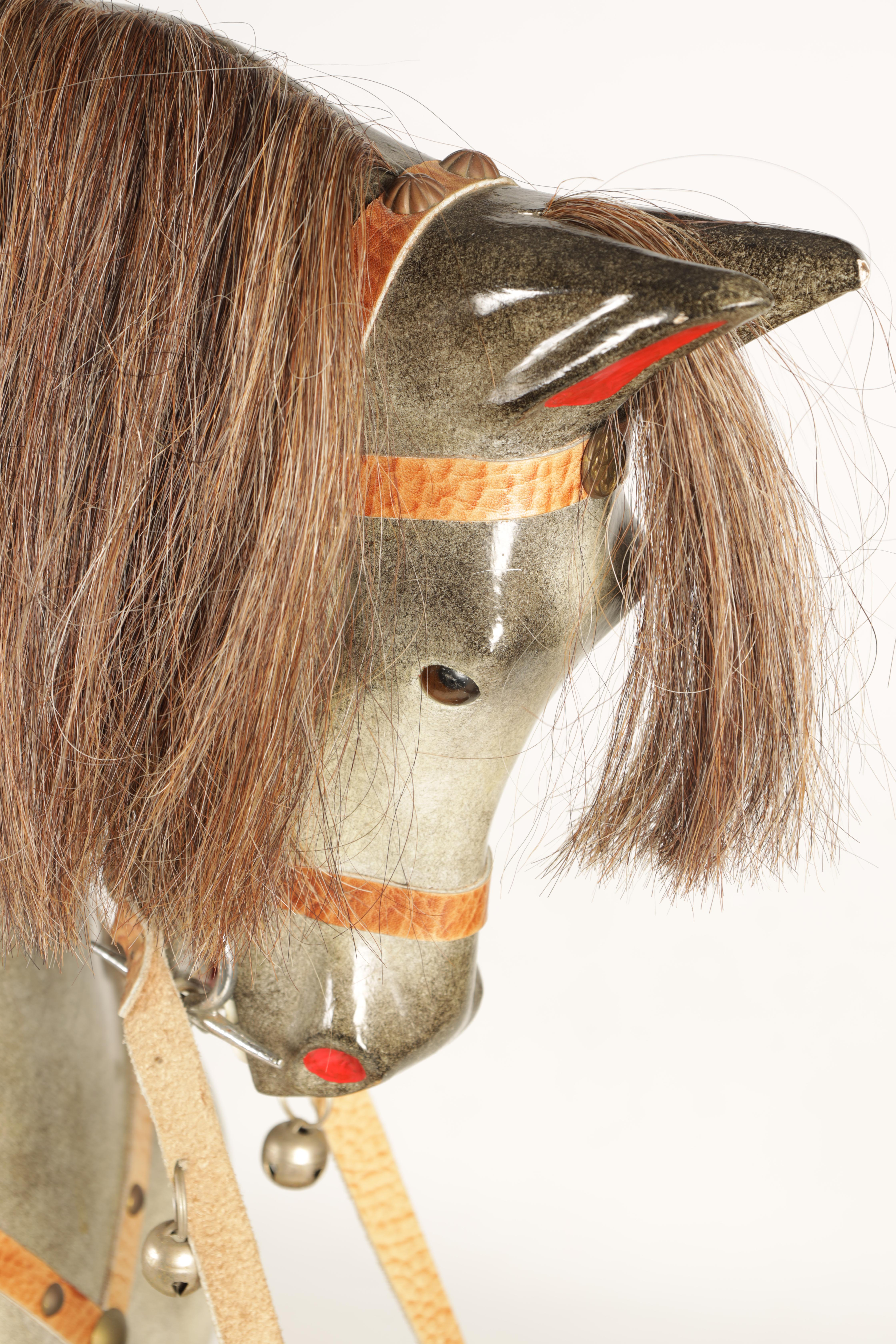 A 20TH CENTURY DAPPLE GREY PAINTED WOODEN ROCKING HORSE with leather seat and bridle 138cm wide - Image 4 of 8