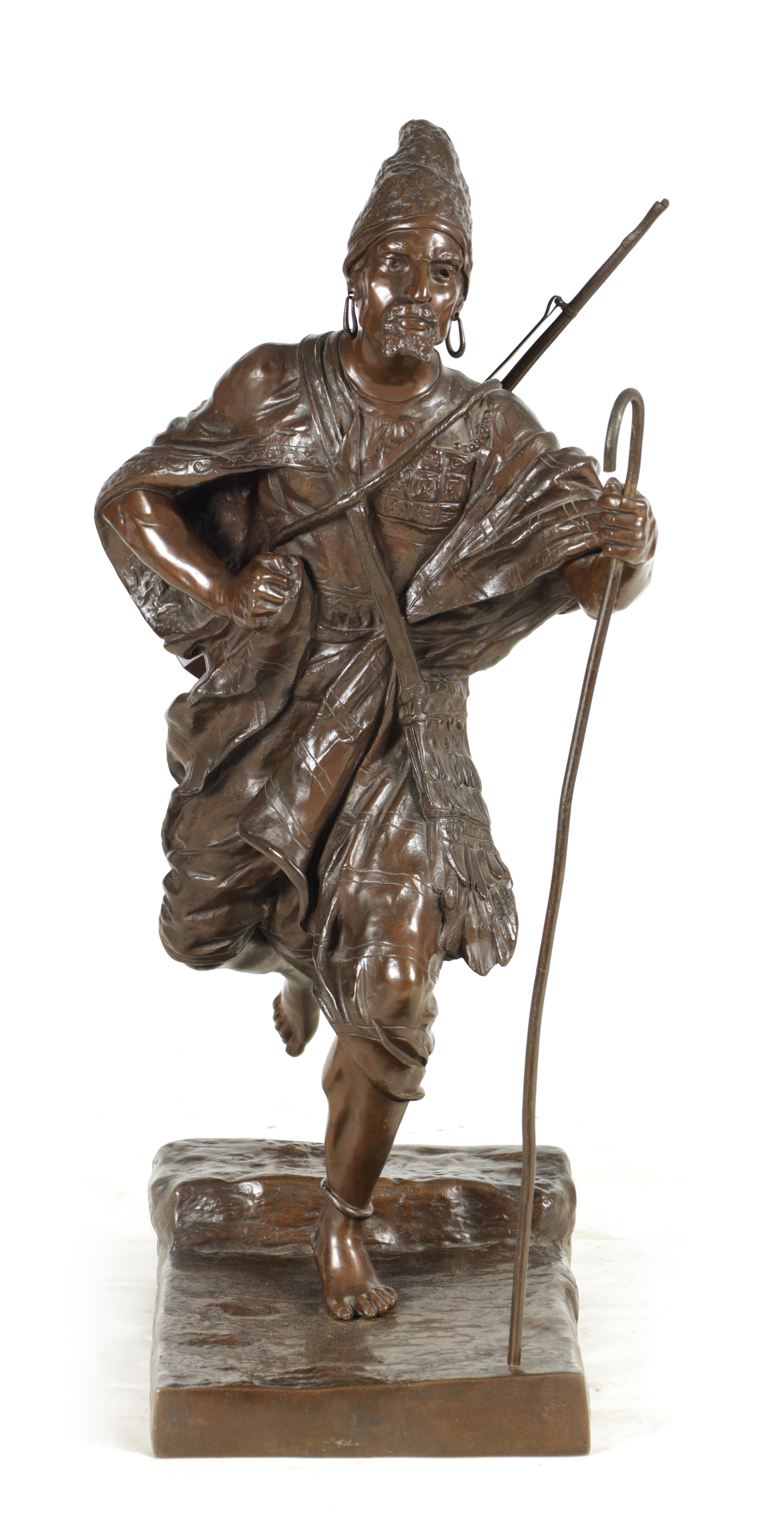 A 19TH CENTURY FRENCH FIGURAL BRONZE depicting an Eastern male figure walking with shepherds crook