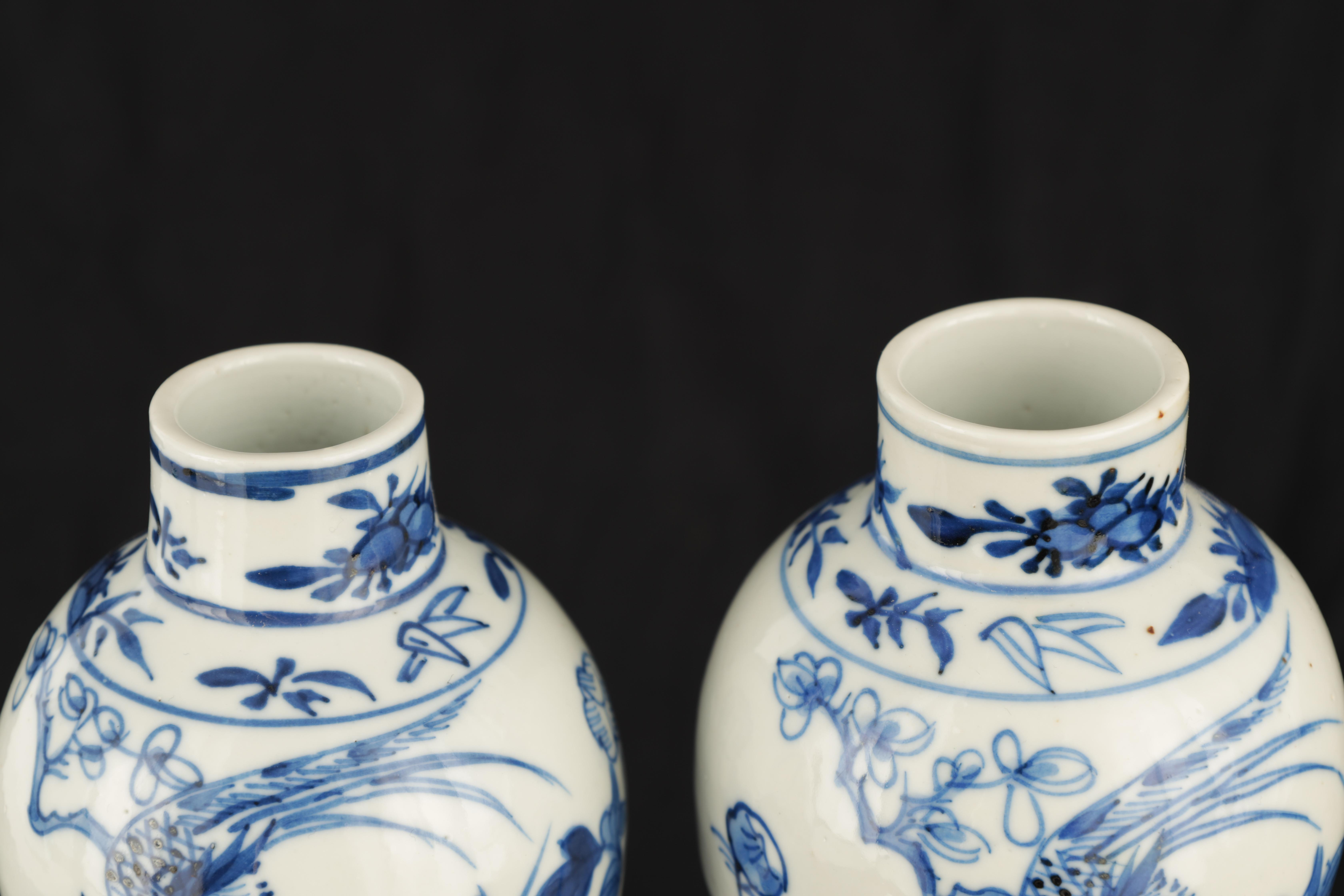 A PAIR OF 19TH CENTURY CHINESE BLUE AND WHITE VASES decorated with blossoming trees and birds 17cm - Image 6 of 9