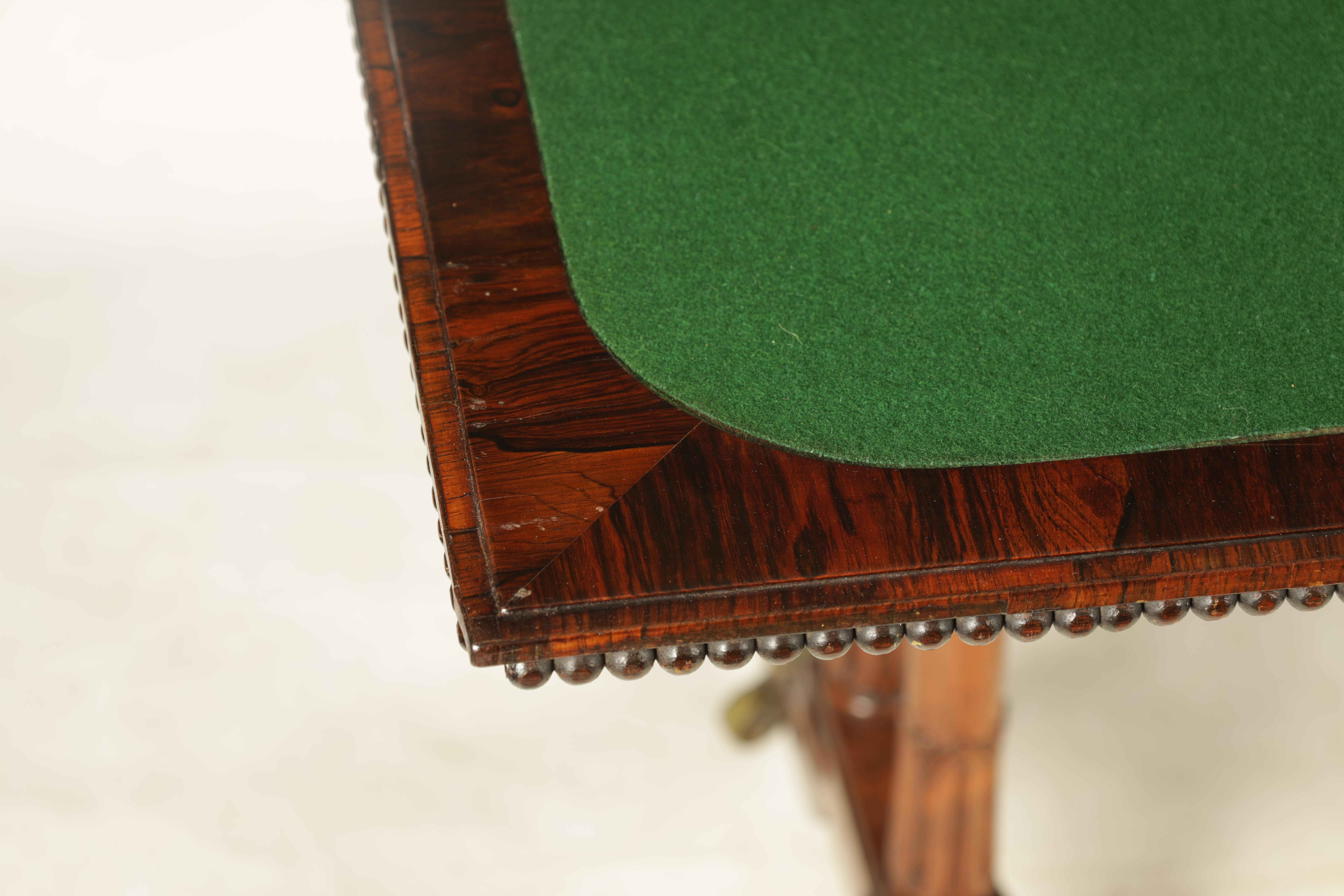 A REGENCY FIGURED ROSEWOOD CARD TABLE IN THE MANNER OF T & G SEDDON with revolving top revealing a - Image 7 of 9