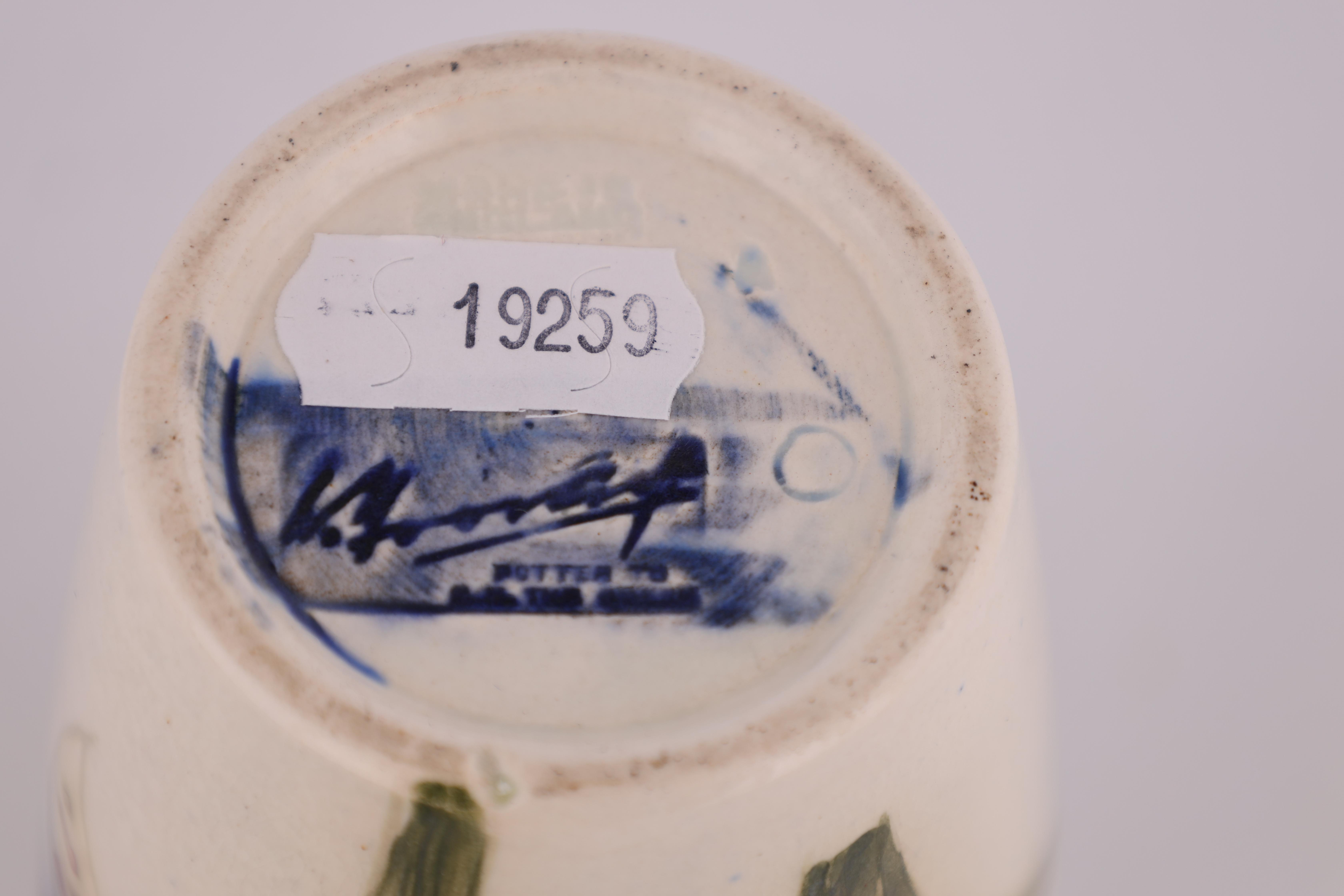 A MOORCROFT SMALL TAPERING SHOULDERED VASE decorated with orchid sprays on a cream ground, 13cm - Image 4 of 4