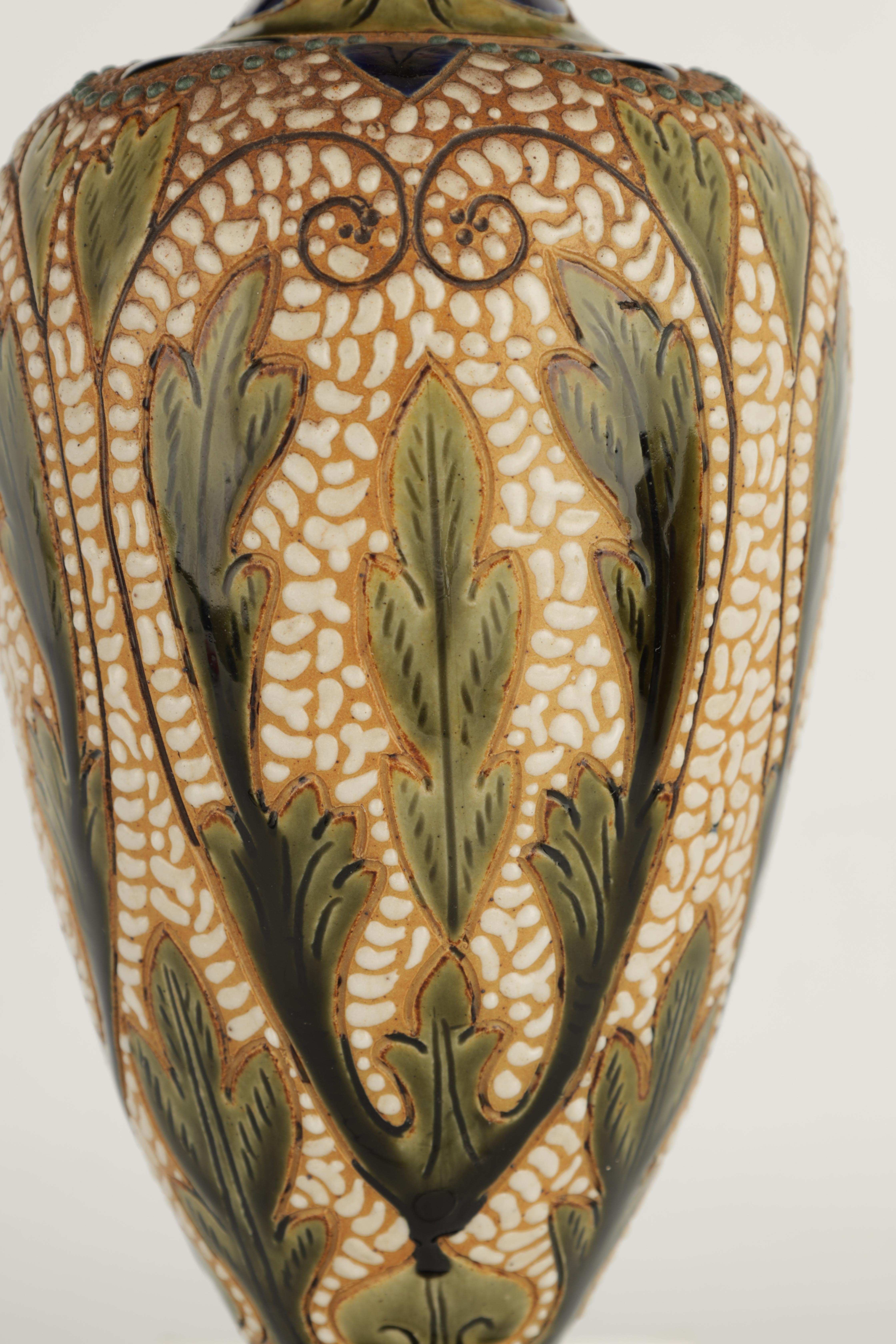 AN UNUSUAL LATE 19TH CENTURY FULHAM POTTERY STONEWARE FOOTED OVOID VASE WITH FLARED RIM decorated - Image 3 of 6
