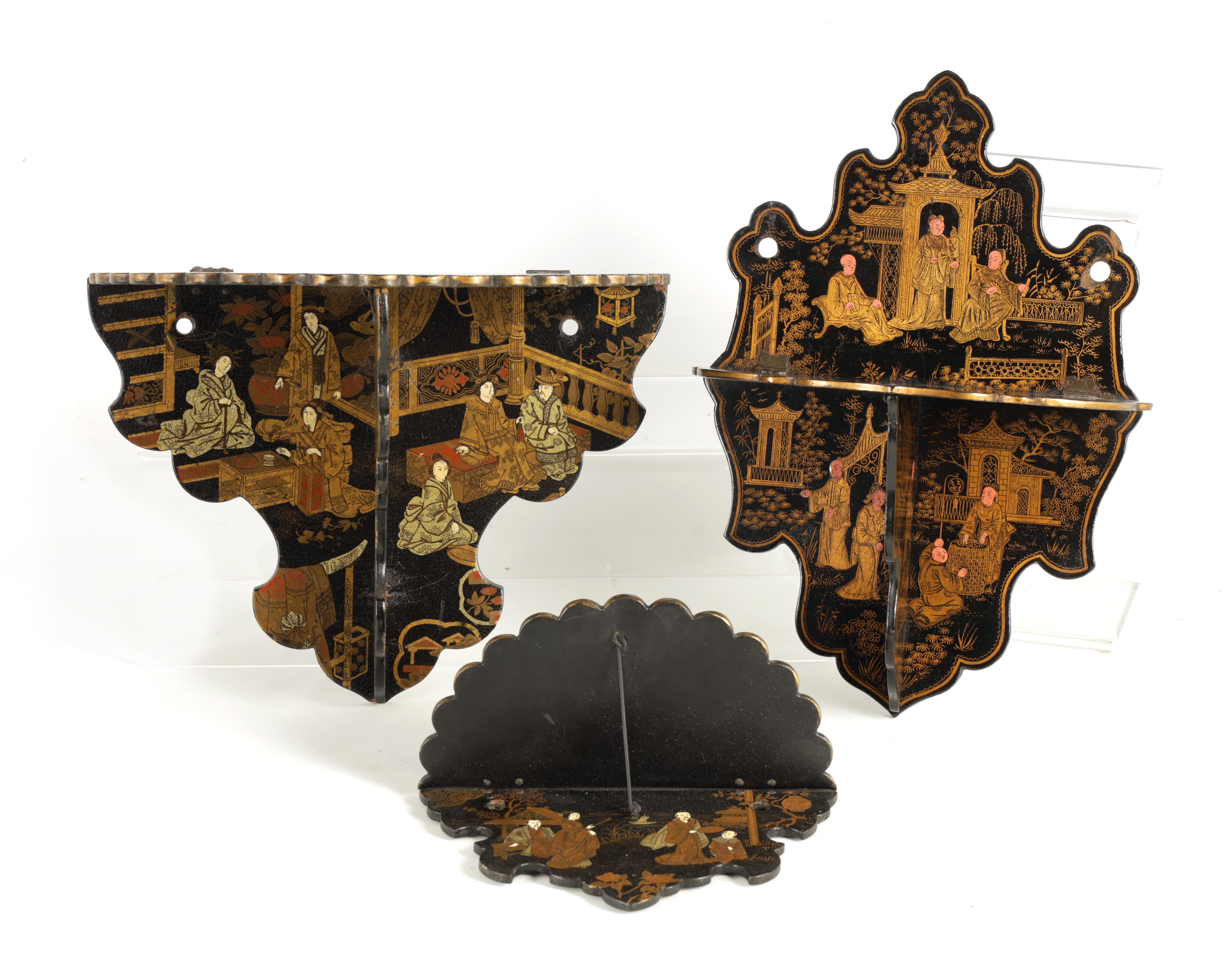 A GROUP OF THREE LATE 19TH CENTURY JAPANESE BLACK LACQUER FOLDING HANGING BRACKETS of shaped form