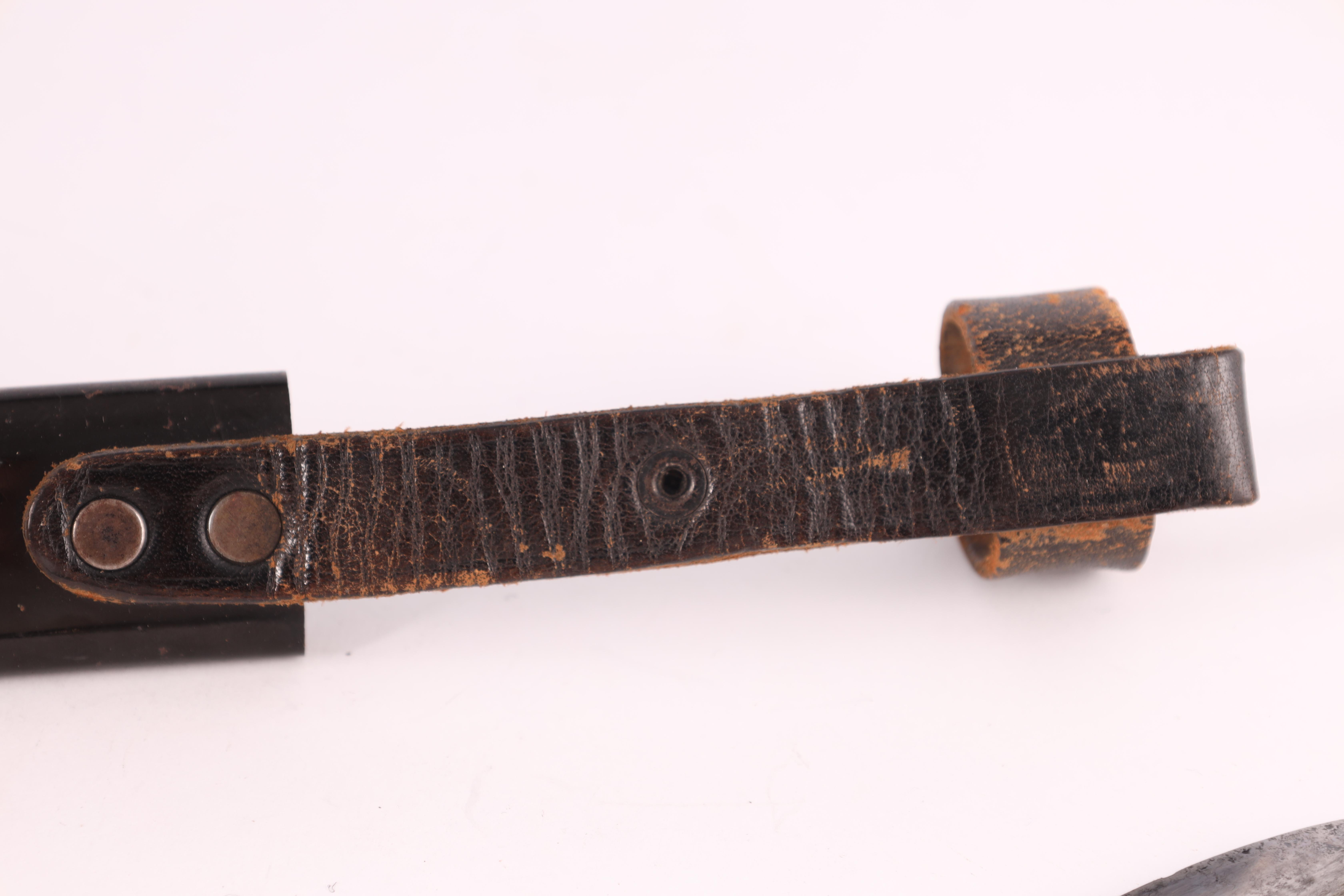 A WORLD WAR II GERMAN NAZI HITLER YOUTH DAGGER with checkered grip set with an enamel swastika badge - Image 9 of 9