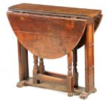 AN UNUSUAL 17TH CENTURY FRUITWOOD SLEDGE FOOT GATELEG TABLE OF SMALL SIZE with hinged sides,
