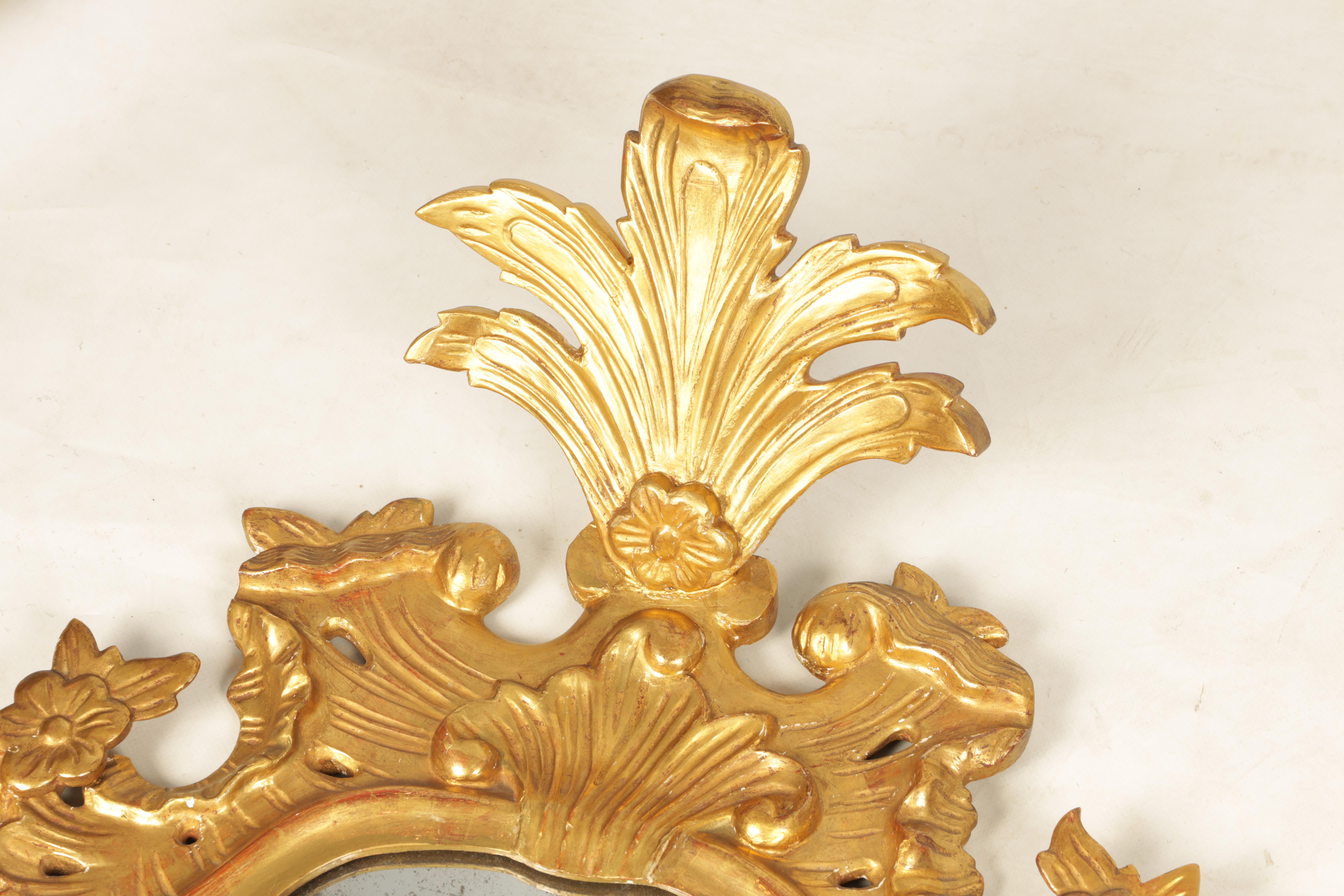 A PAIR OF 19TH CENTURY CARVED GILT WOOD ITALIAN FLORENTINE MIRRORS with leaf and shell carved frames - Image 3 of 8