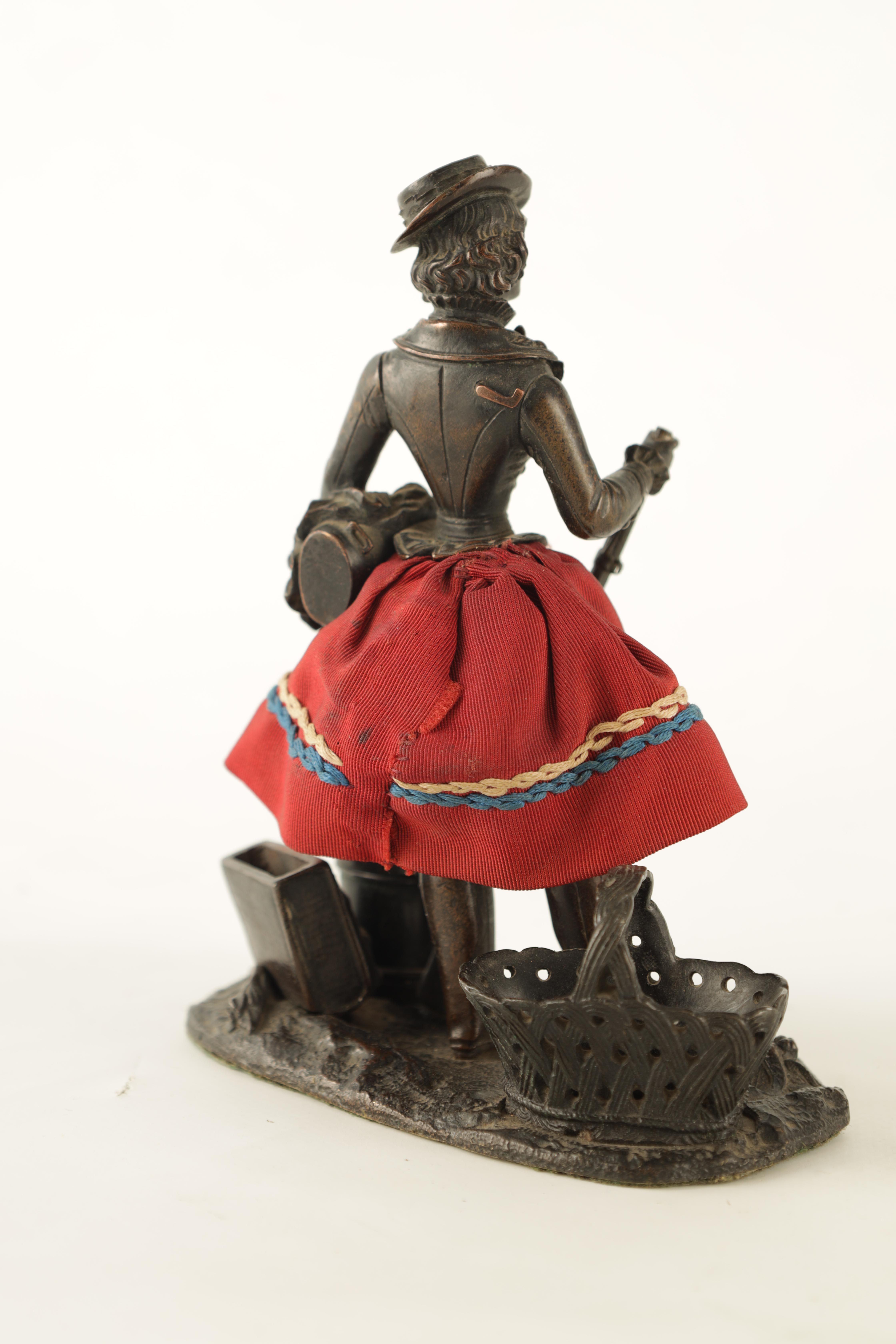 A LATE 19TH CENTURY NOVELTY BRONZE DESK COMPENDIUM DEPICTING A LADY HOLDING A RIFFLE with red - Image 3 of 10