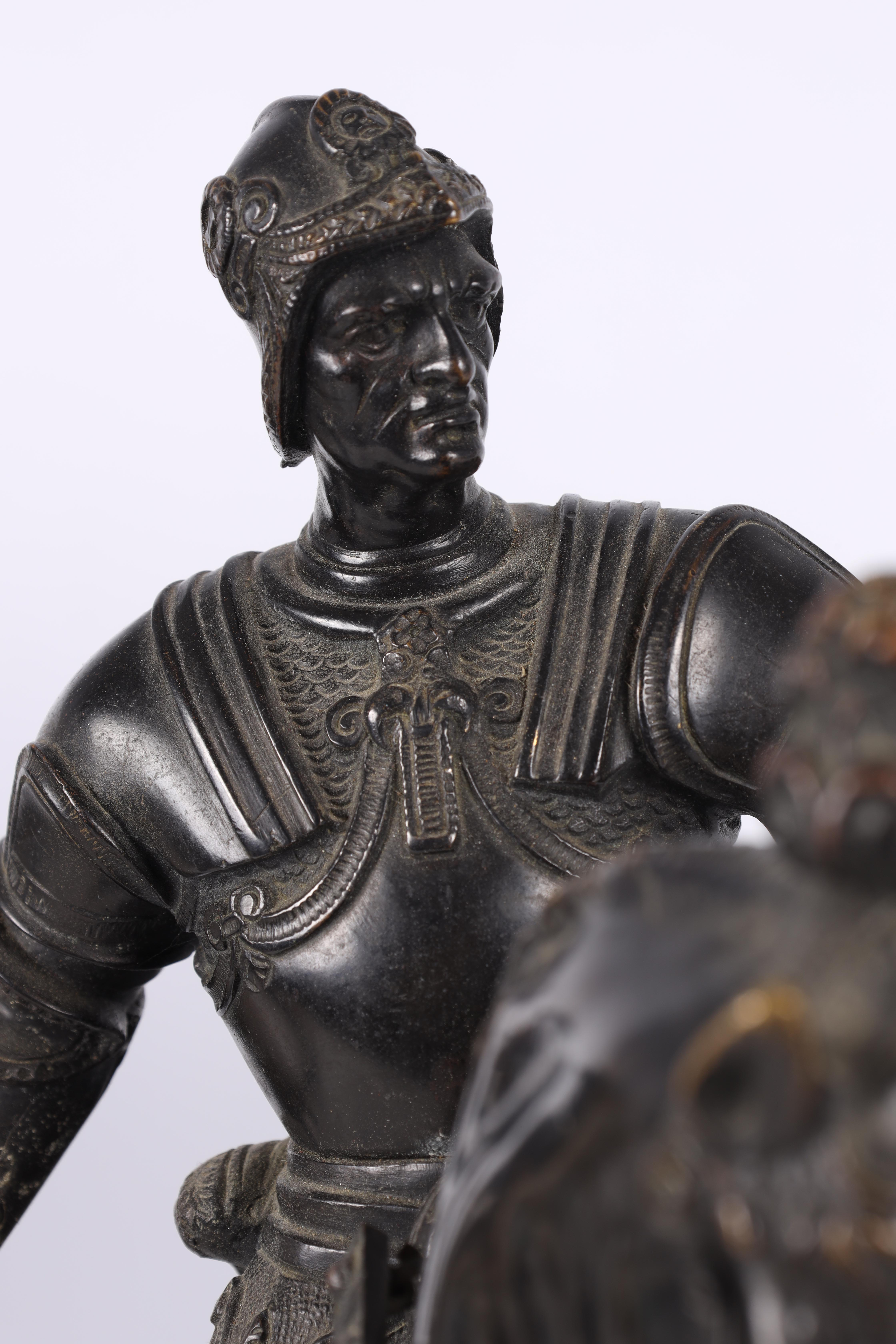 A LATE 19TH CENTURY PATINATED BRONZE EQUESTRIAN SCULPTURE modelled as a Knight on horseback of - Image 6 of 8