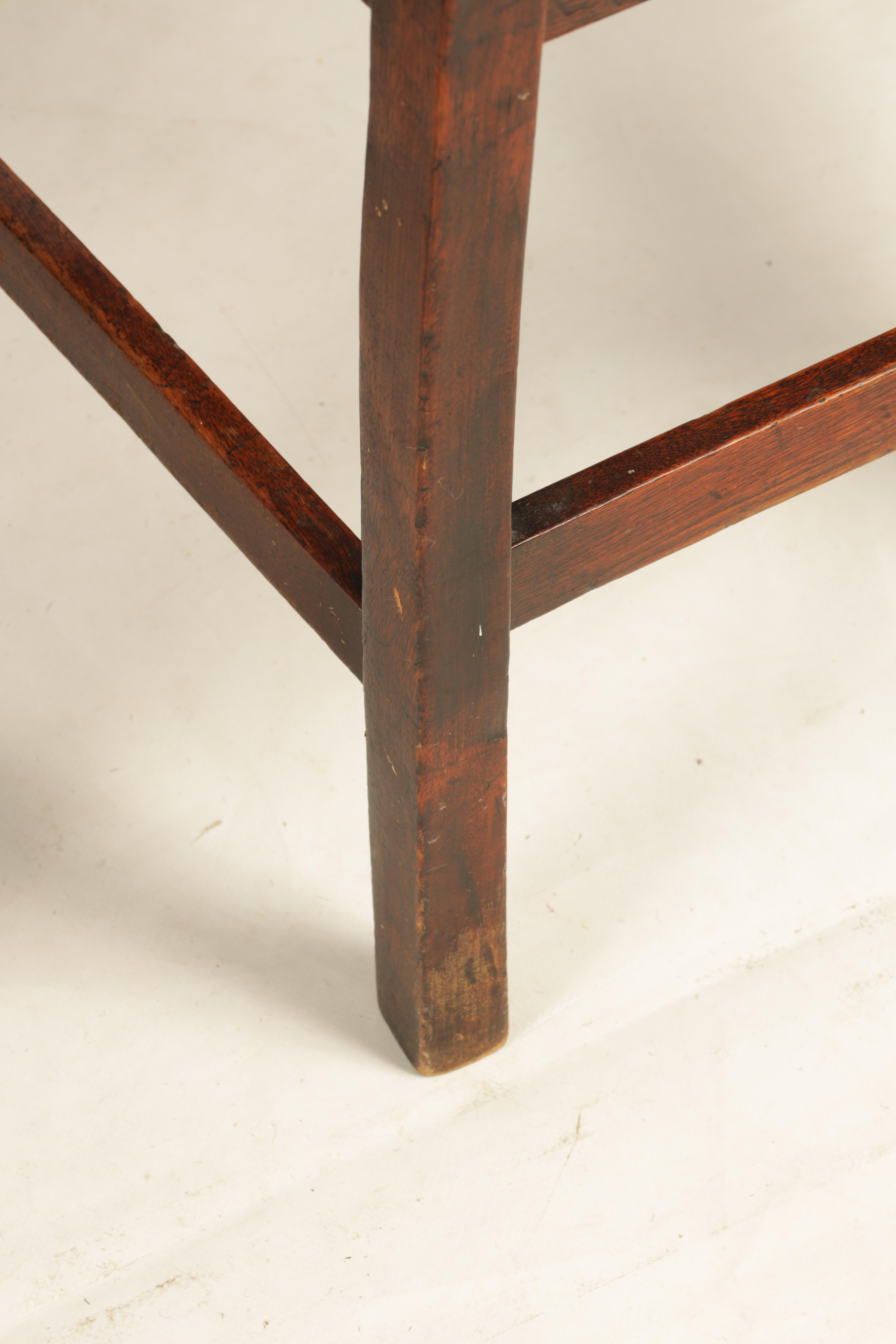 A SET OF SIX 19TH CENTURY COUNTRY FRUITWOOD DINING CHAIRS with rush seats and bar backs; standing on - Image 6 of 9
